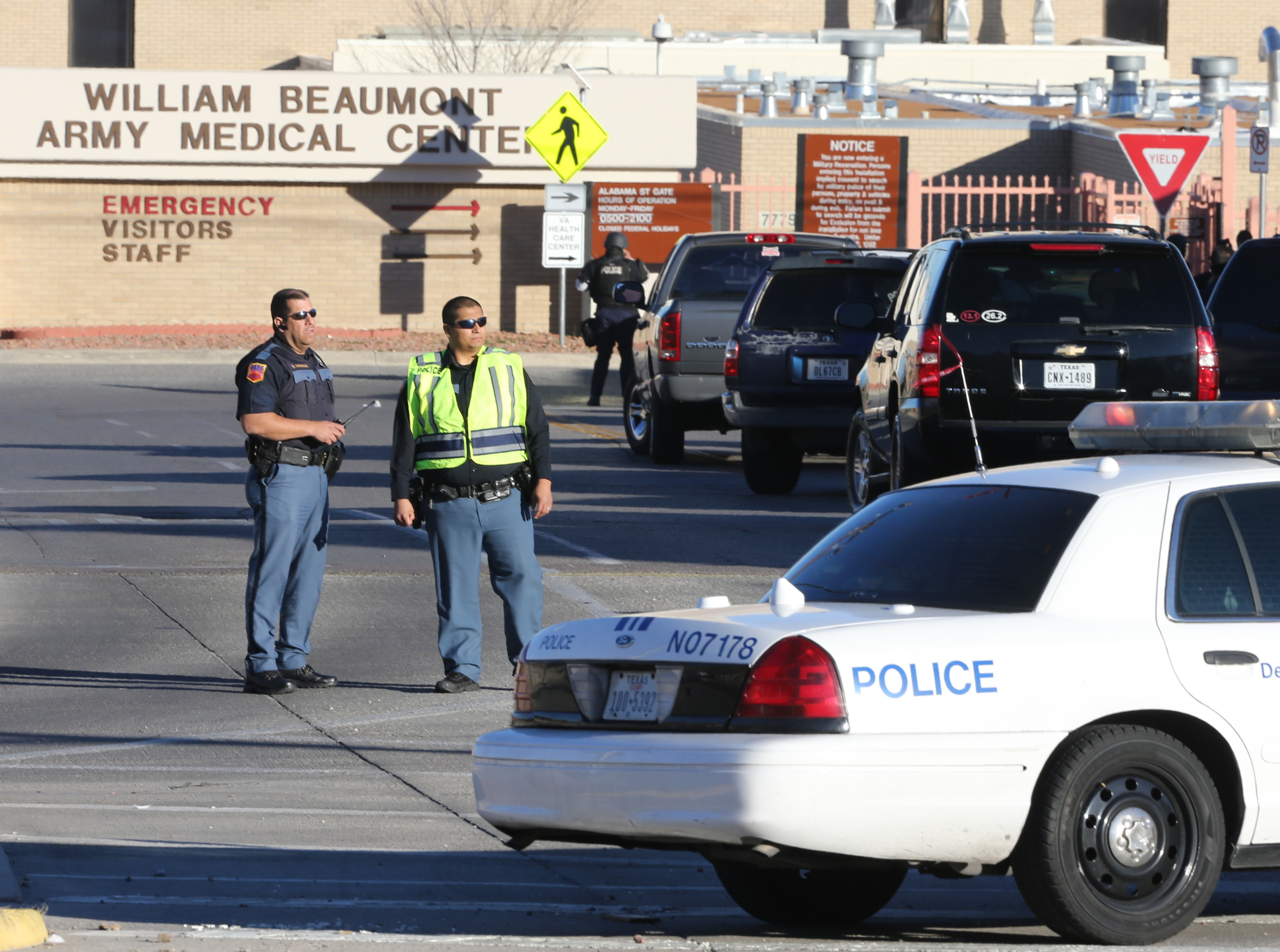 Police officers guard an entrance to the Beaumont Army Medical Center/El Paso VA campus during the search for a gunman Tuesday, Jan. 6, 2015