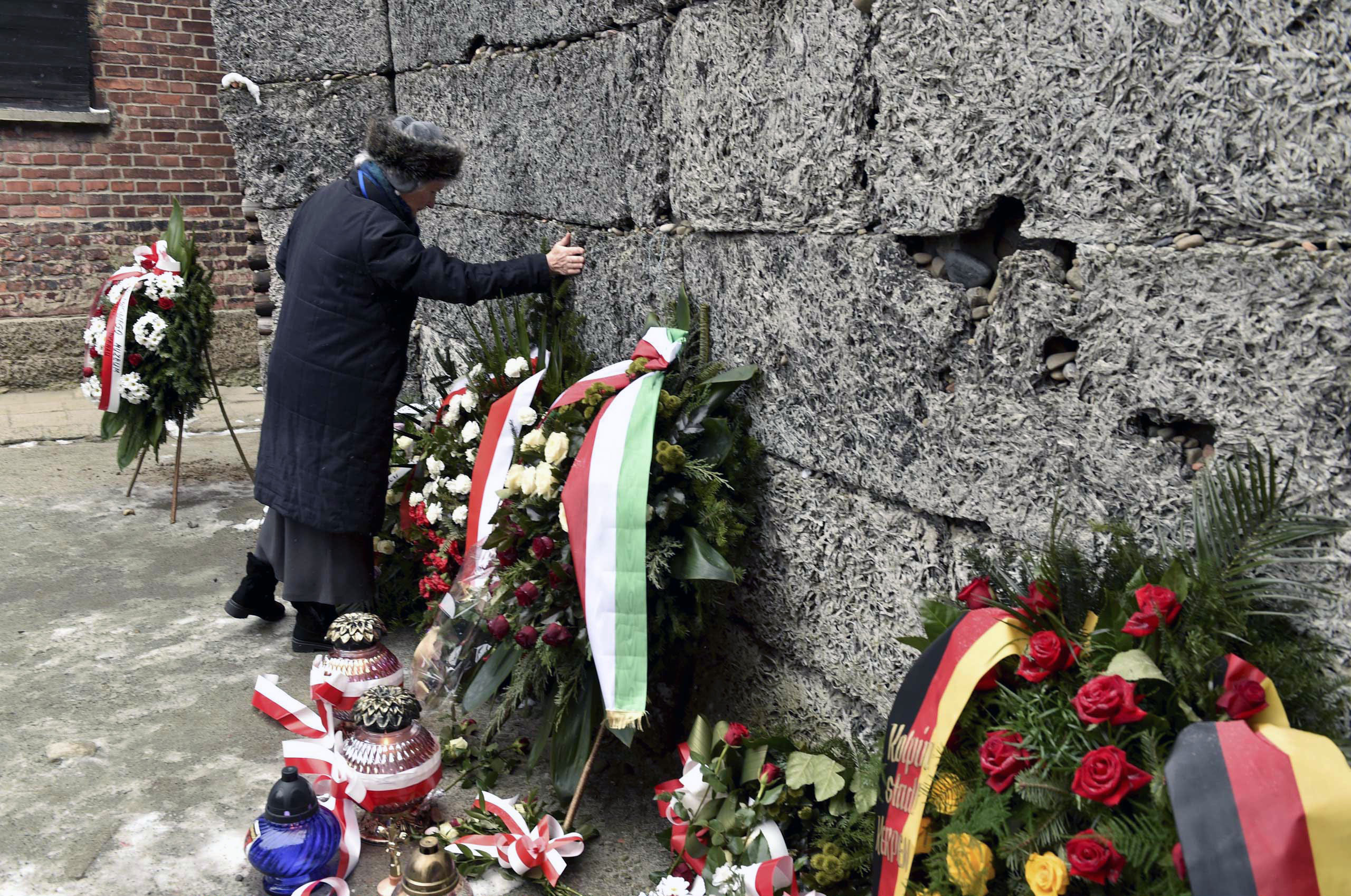Survivors laying wreaths at the Wall of Death during the 70th anniversary of the liberation of the Nazi German concentration and extermination camp, Auschwitz-Birkenau on Jan. 27, 2015.