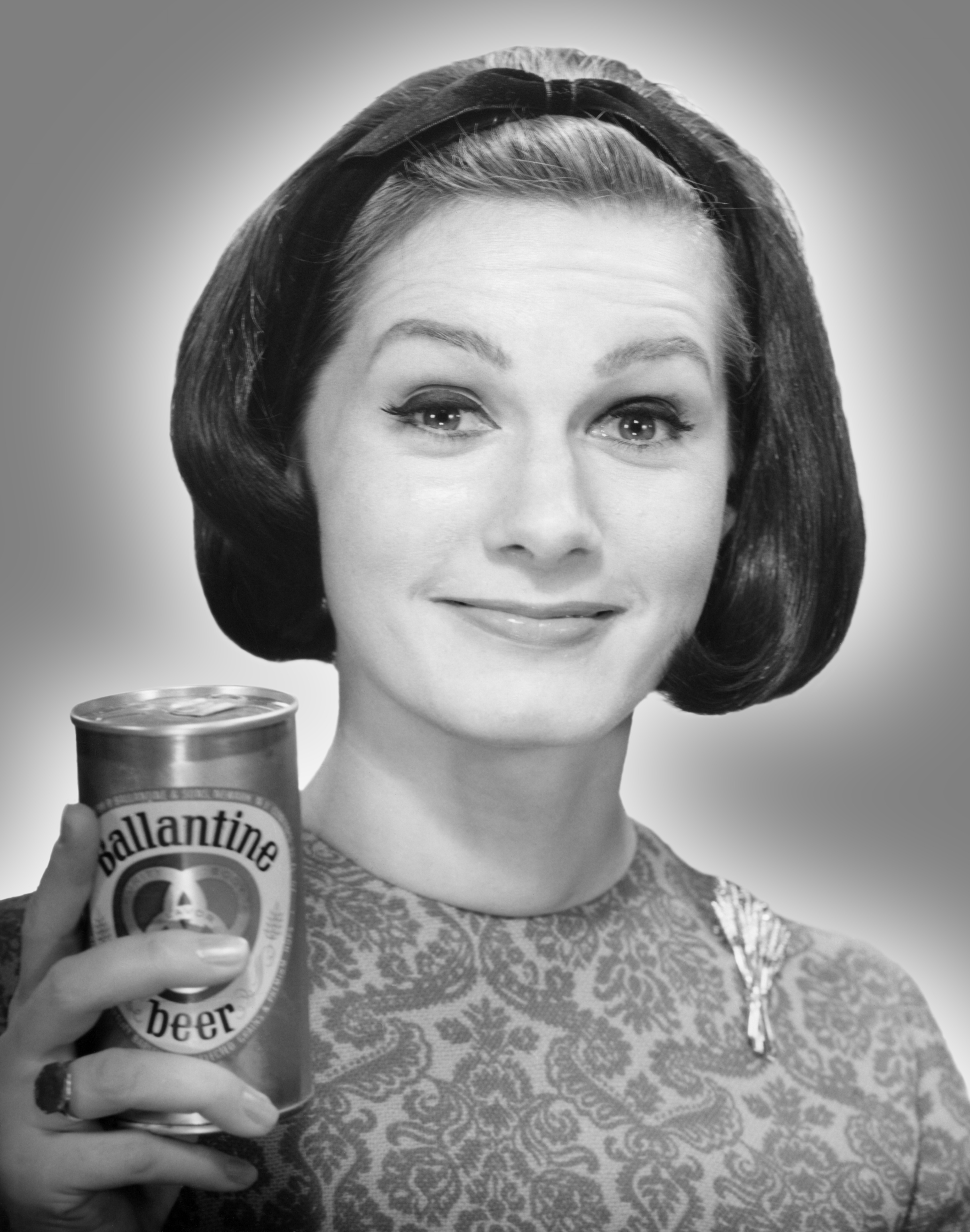 Woman holding can of beer, circa 1950s.