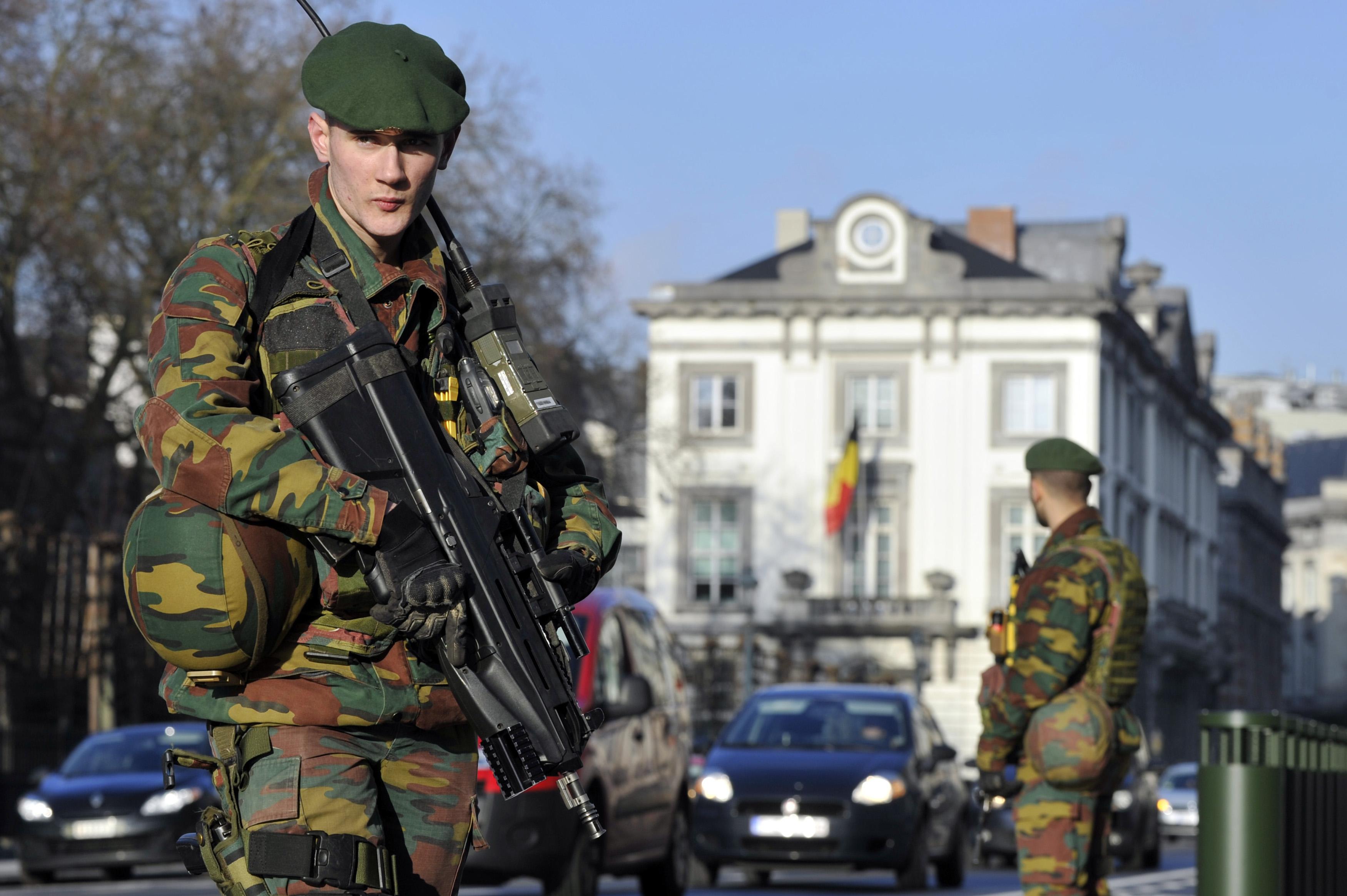 Belgian soldiers guard outside the U.S. Embassy in Brussels near the Belgian Parliament on Jan. 17, 2015.
