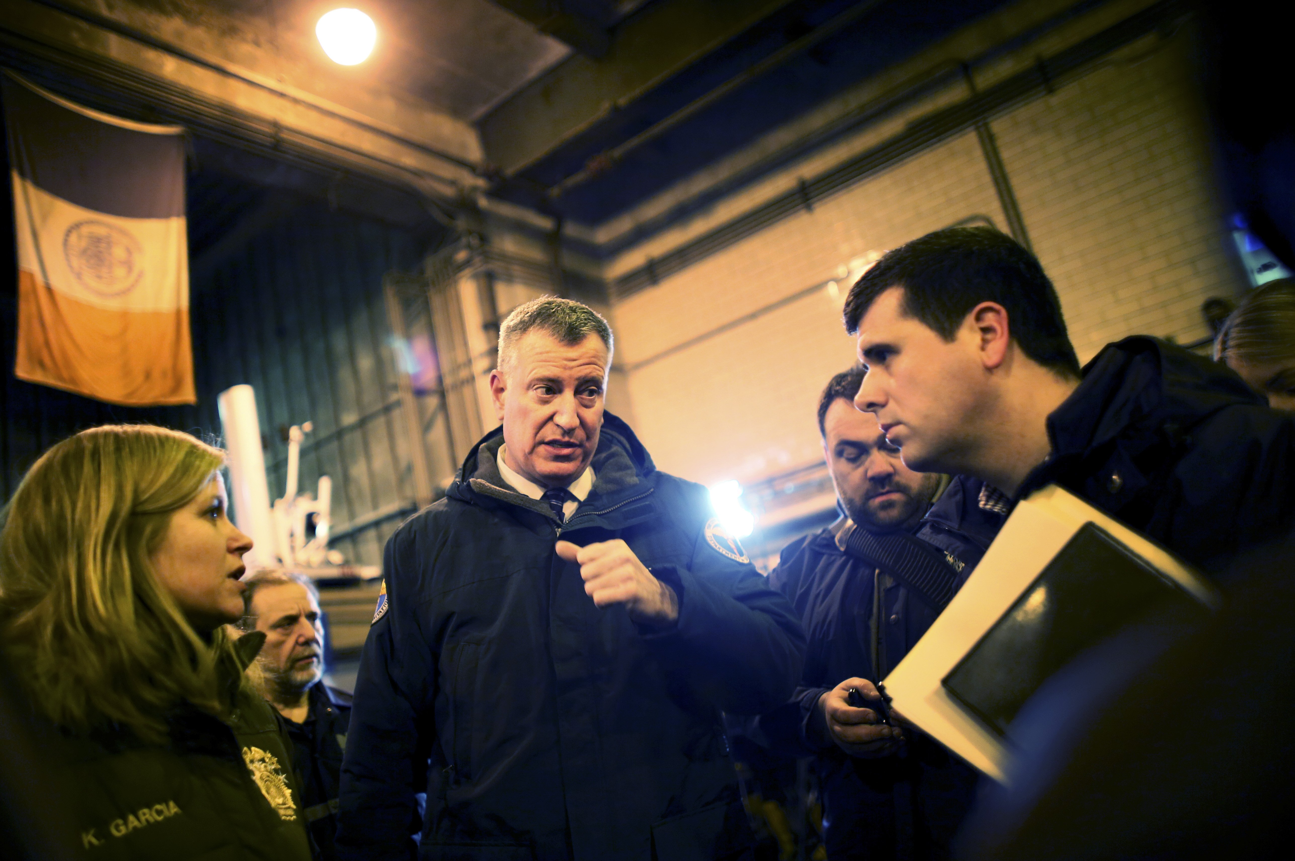 New York City Mayor Bill de Blasio exits a news conference with Department of Sanitation workers in preparation for a blizzard in New York City, Jan. 26, 2015.