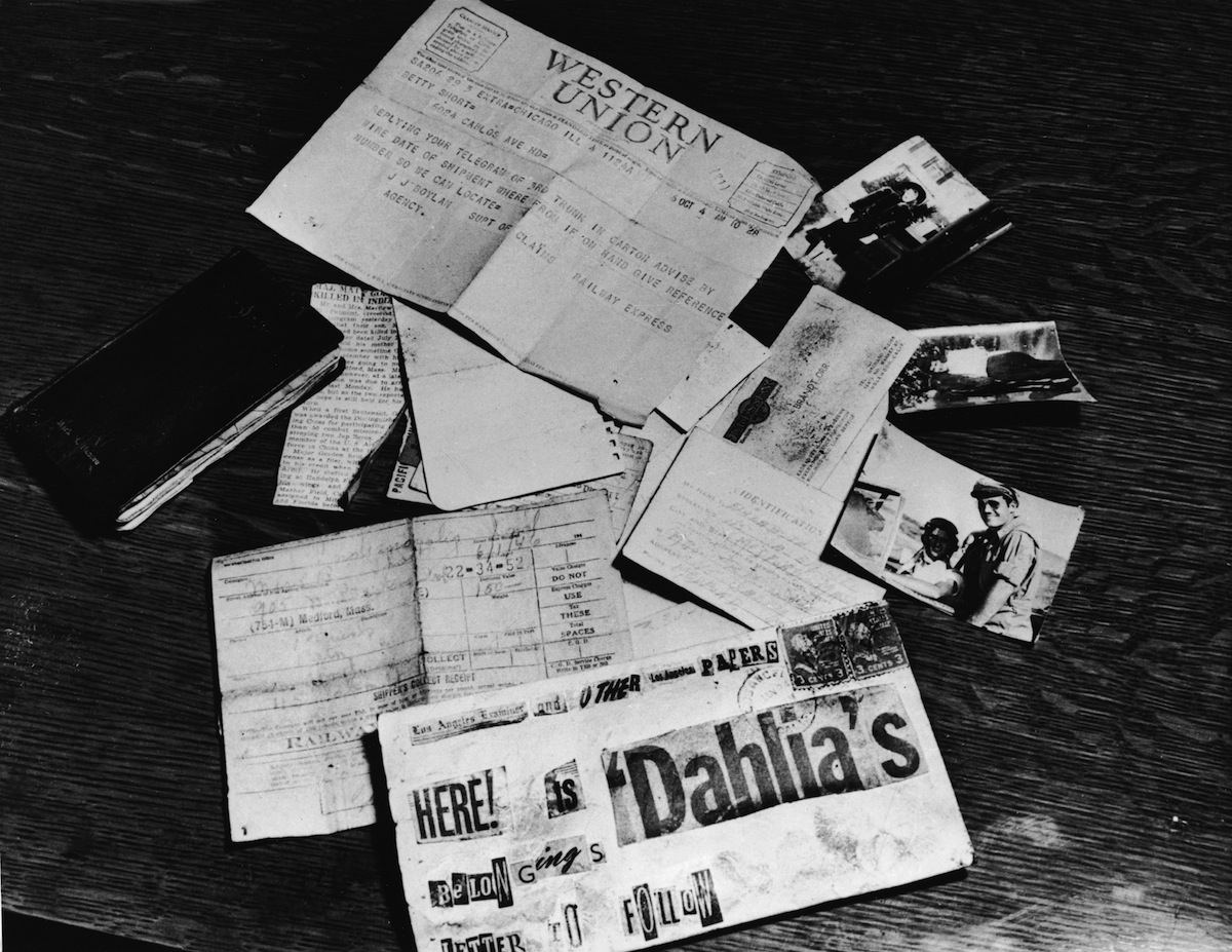 Evidence concerning the murder of American aspiring actress and murder victim Elizabeth Short (1924 - 1947), known as the 'Black Dahlia,' is strown across a table at the Los Angeles District Attorney's office in 1947.
