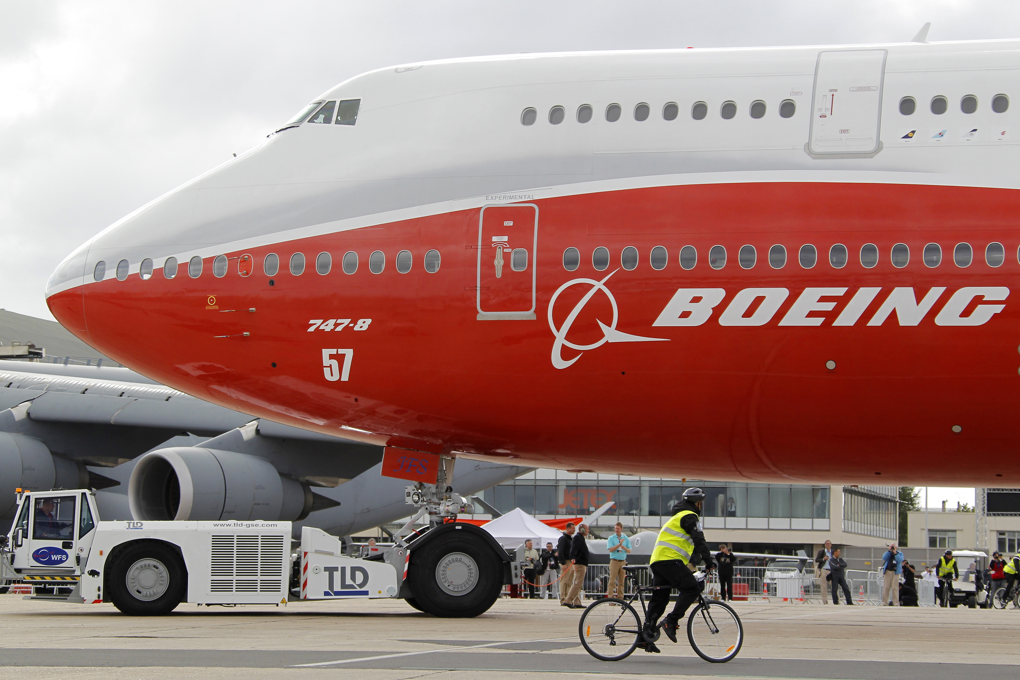 Workers move the new Boeing 747-8 jetliner into a static display on the eve of the Paris Air Show at Le Bourget airport near Paris on June 19, 2011