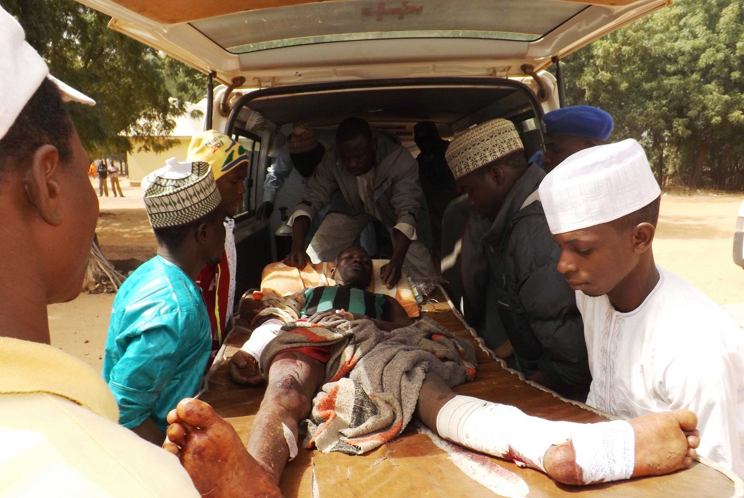 A man injured in a suicide blast is transported to the General Hospital in the northeast town of Potiskum, Nigeria on Jan, 12, 2015.