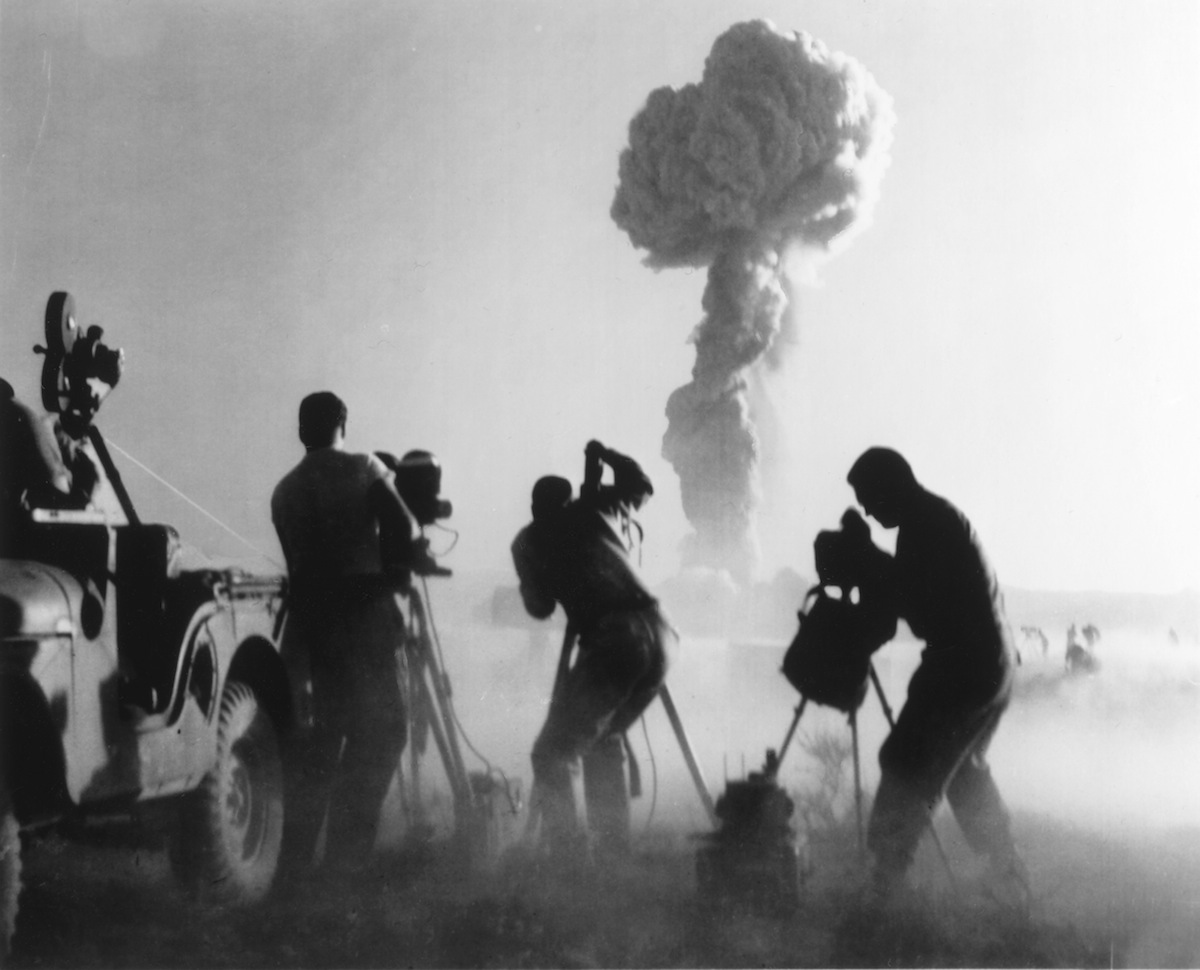 Capturing an atomic explosion at a test site in the Nevada desert in 1957.