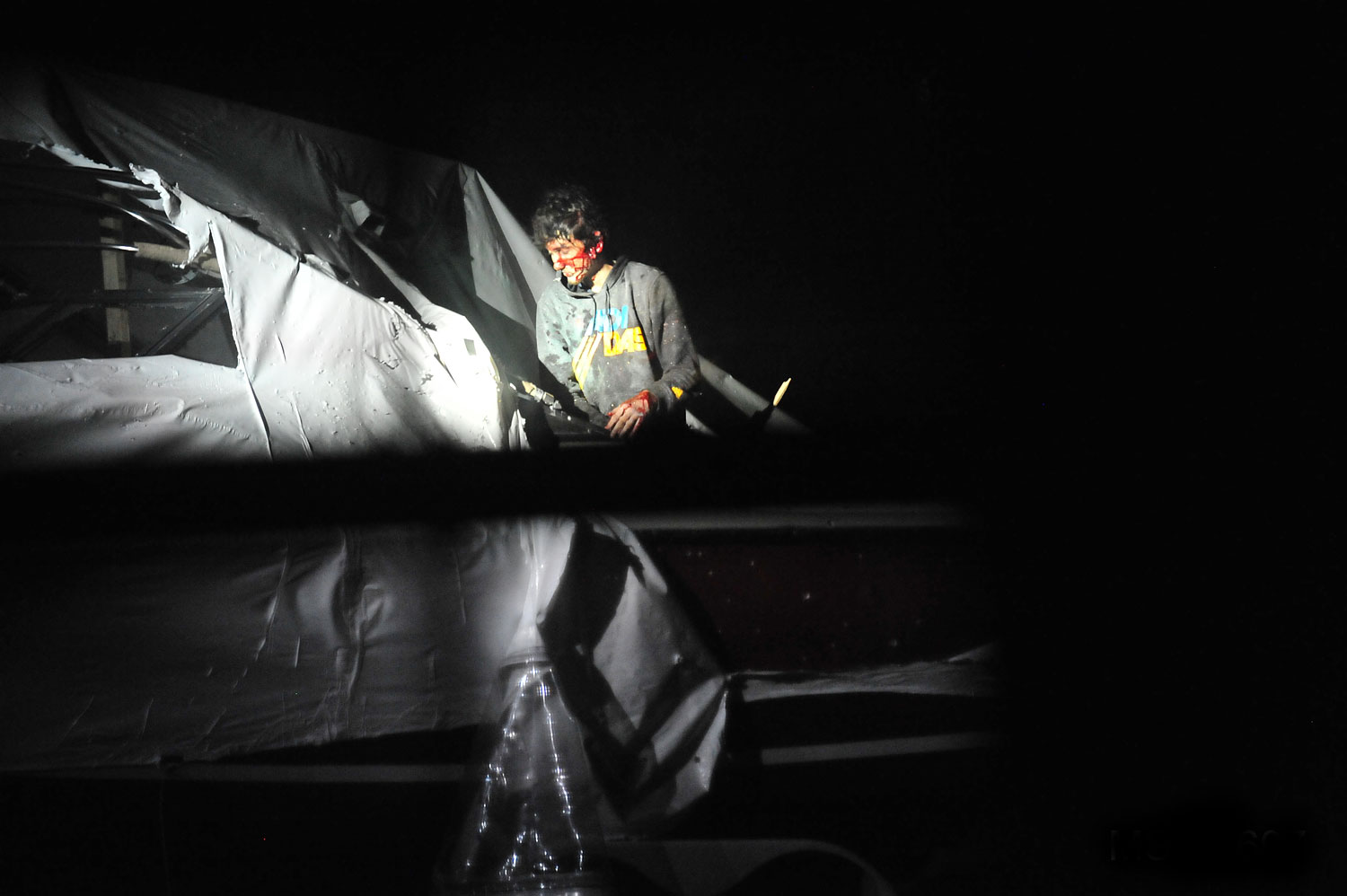 <b>7:31:11 p.m.</b> Tsarnaev stands in the boat.