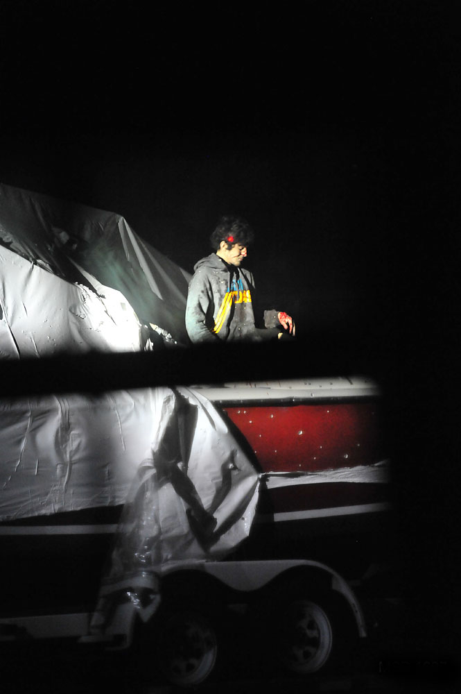 <b>7:31:23 p.m.</b> Tsarnaev stands in the boat with the red dot of a rifle's laser sight locked on his head.