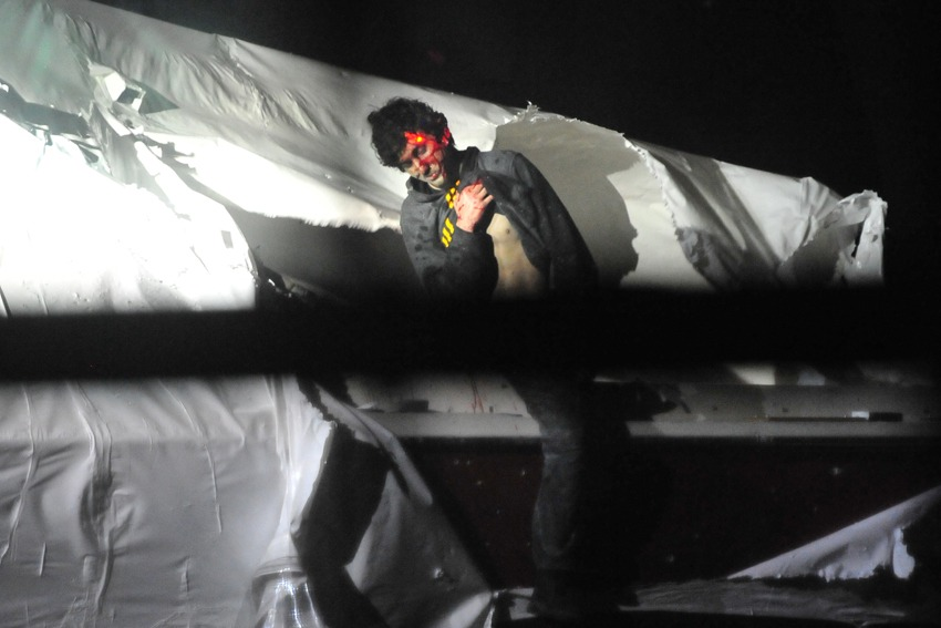 <b>7:32:10 p.m.</b> Tsarnaev raises his shirt to show that he is not armed or concealing an explosive device.
