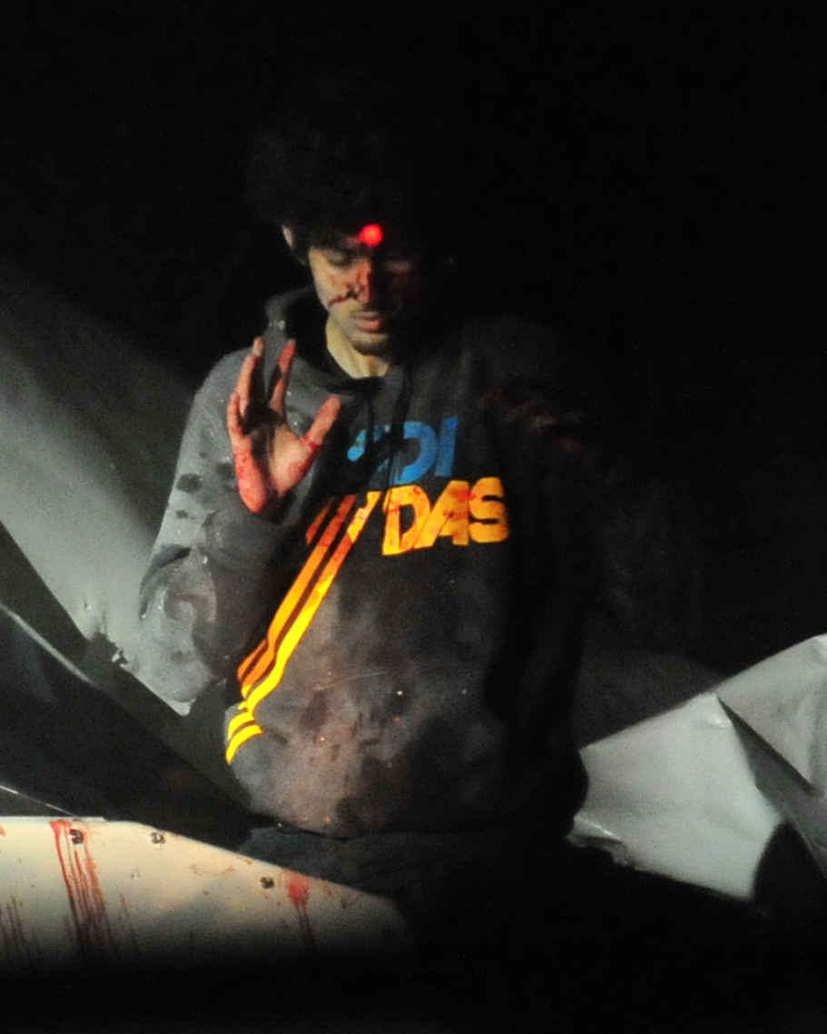 <b>7:39:48 p.m.</b>Tsarnaev stands in the boat with his hands raised.