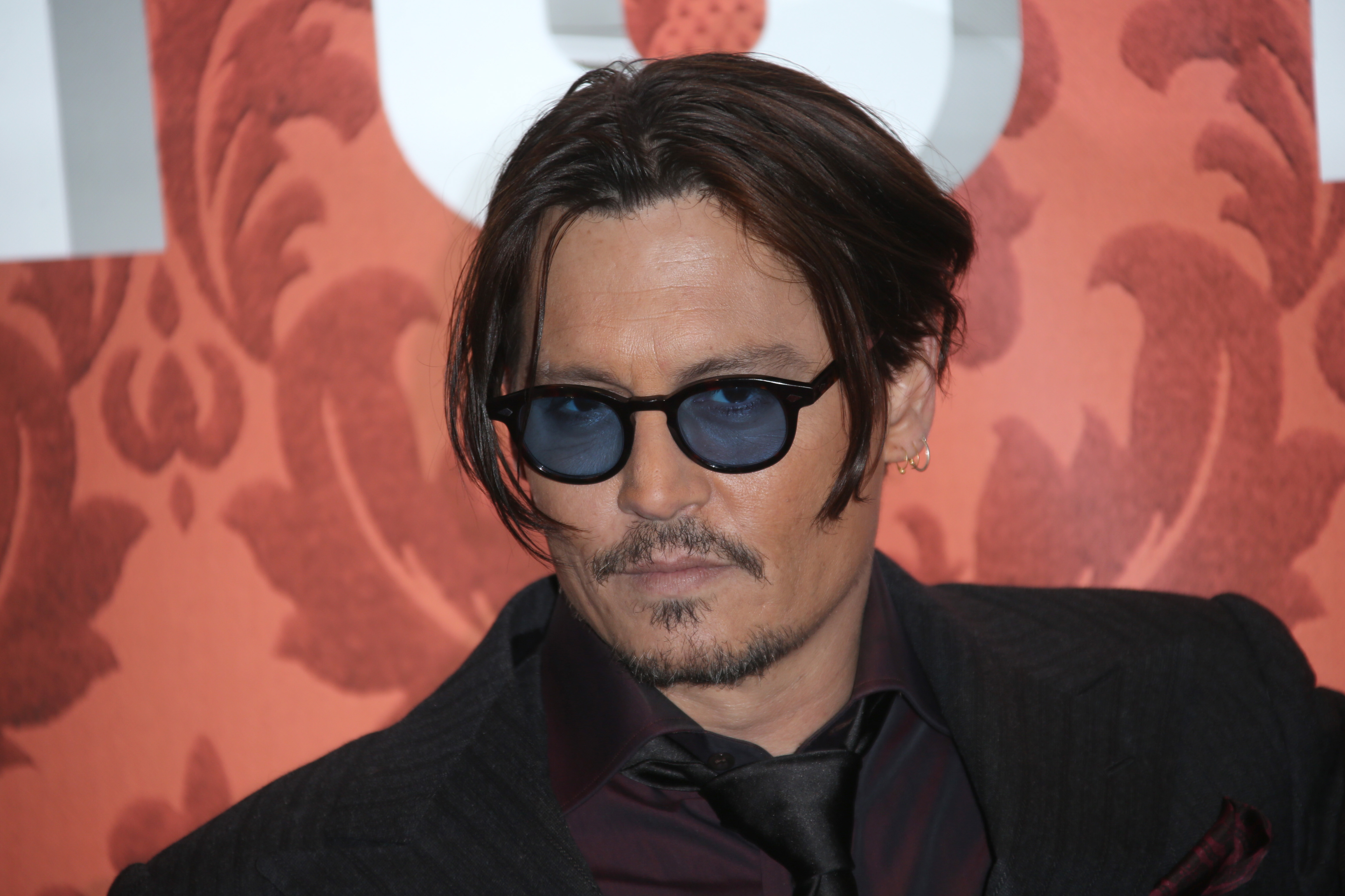 Actor Johnny Depp poses for photographers upon arrival at the premiere of the film Mortdecai, in London, Jan. 19, 2015.
