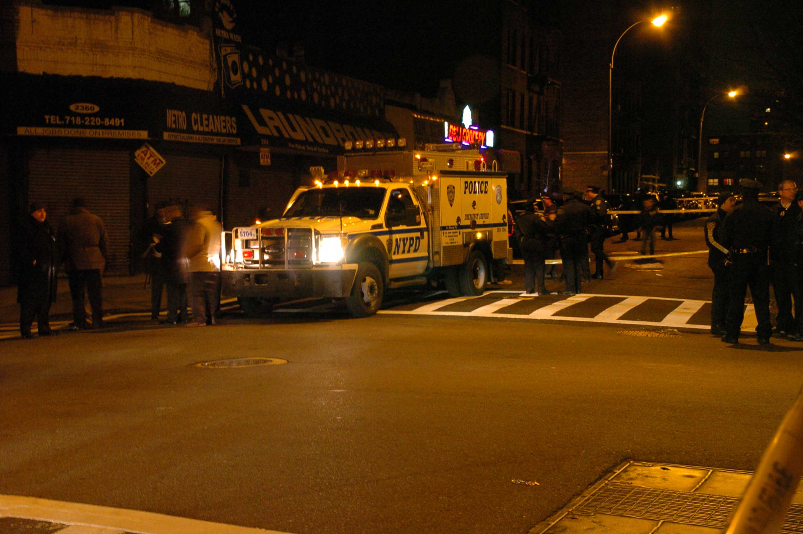 Police officers patrol the crime scene where two NYPD officers were shot in the Bronx borough of New York City, early on Jan. 6, 2014.