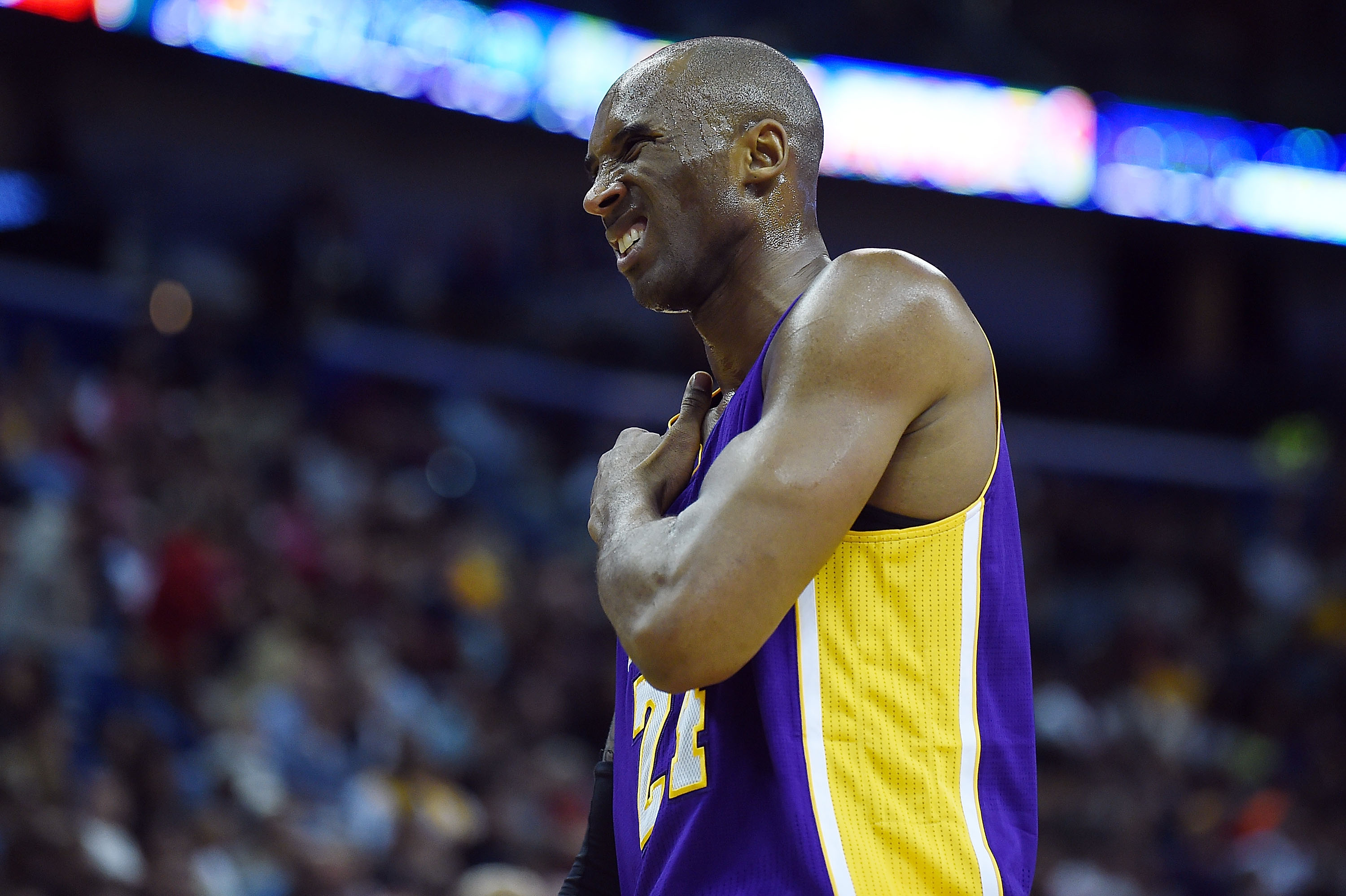 Kobe Bryant grabs his shoulder during a game at the Smoothie King Center on Jan. 21, 2015 in New Orleans.