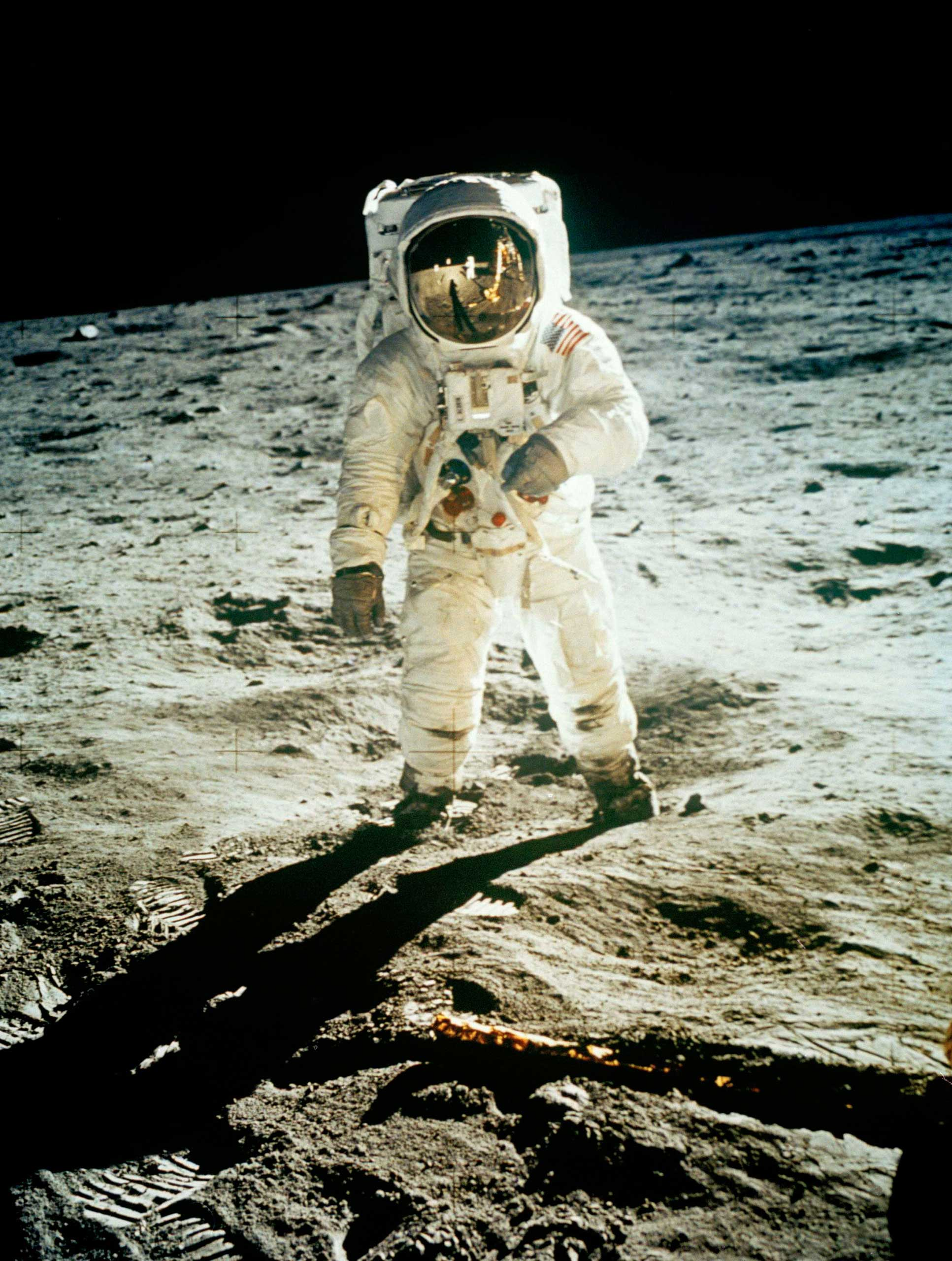 One small step for man, one giant leap for mankind  were the first words spoken on the moon by Neil Armstrong who can be seen in the reflection of Aldrin's helmet. There are actually no good photos of Armstrong while on the moon because he was the one holding the camera most of the time.