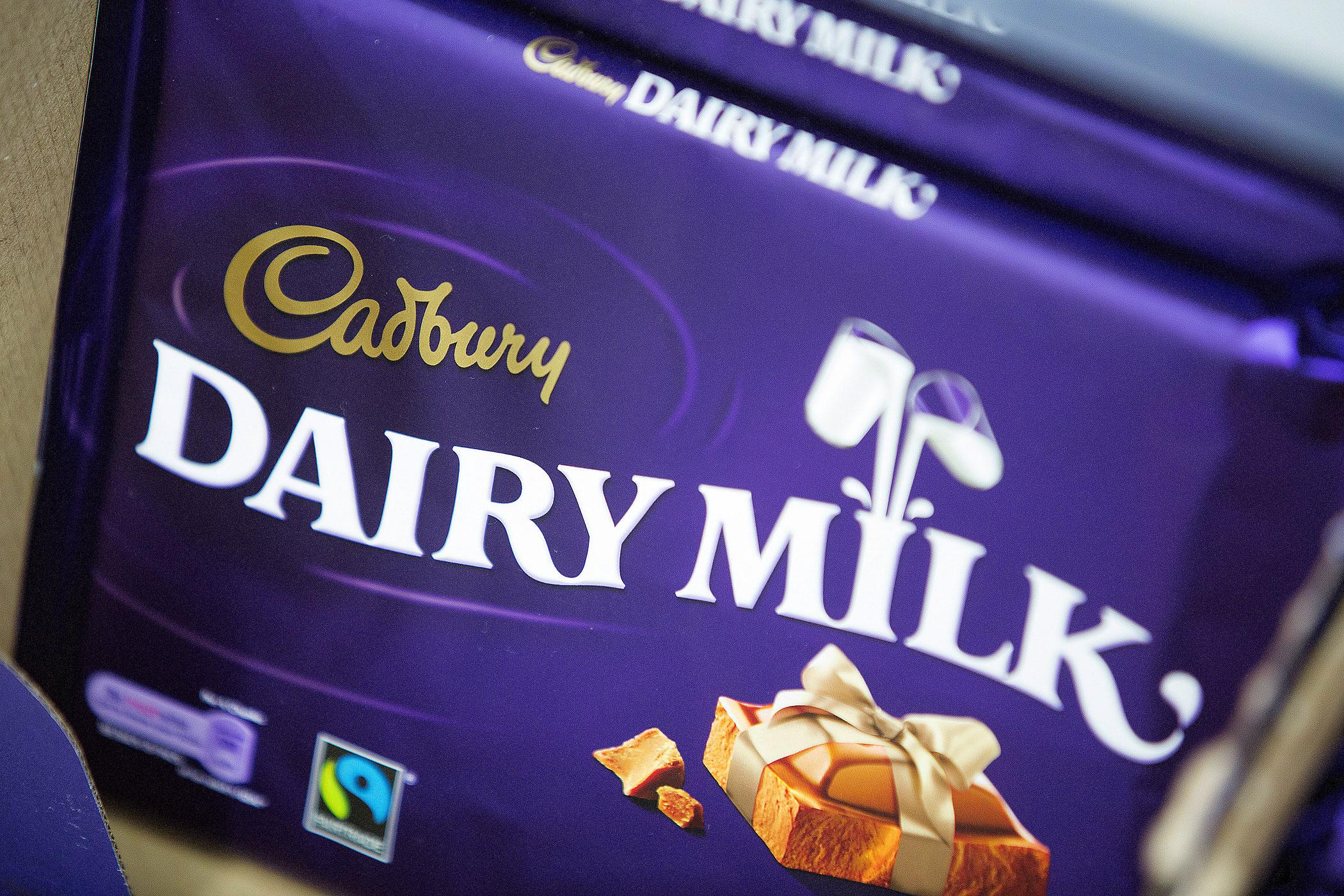 Cadbury  Dairy Milk  chocolate is displayed for sale inside an Asda supermarket in Watford, U.K., on Oct. 17, 2013.