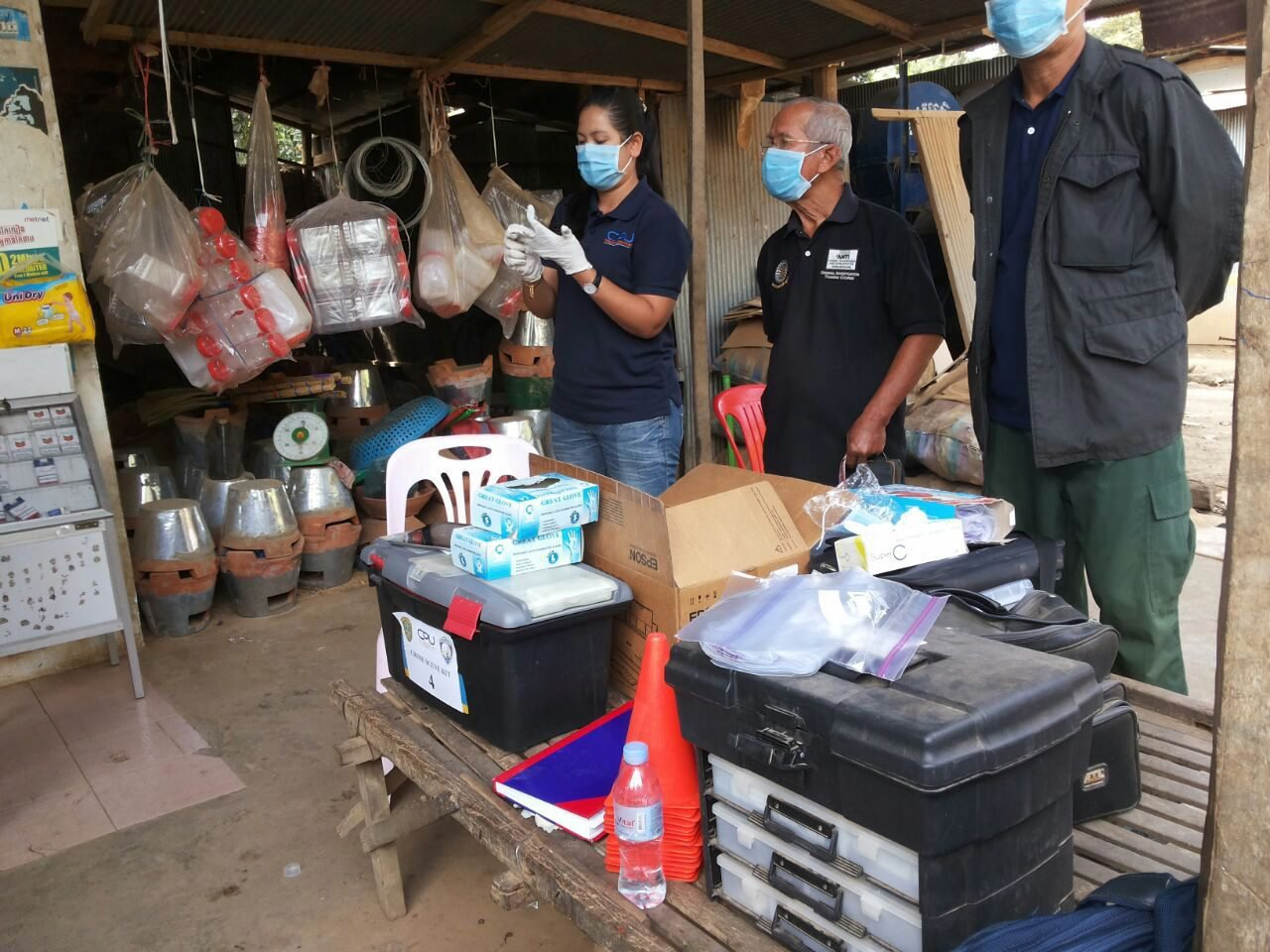 Cambodian officials prepare to inspect the perimeter of a nurse house after a local unlicensed doctor was charged with spreading HIV, in Roka commune in Battambang province, Cambodia, on Dec. 17, 2014.