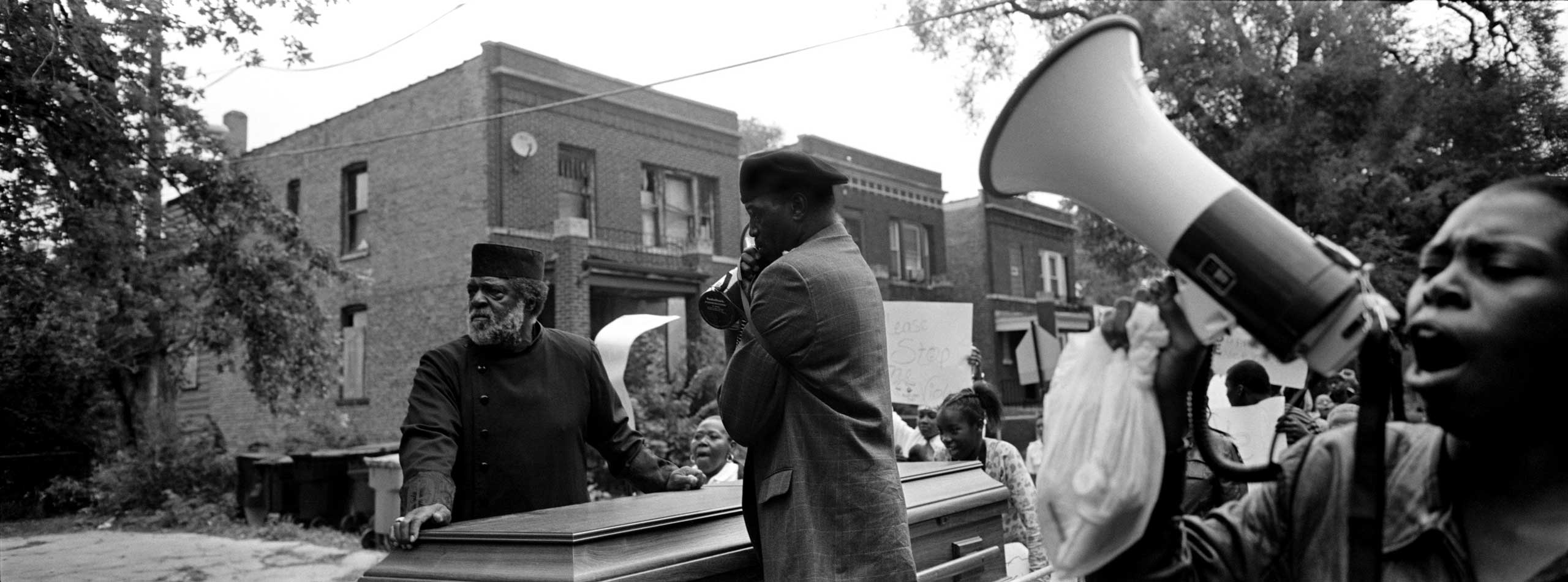 Angry community members, business owners and church pastors marched through Chicago's South Side to protest the overwhelming numbers of murders that took place in October of that year. Greater Grand Crossing, Chicago, 2009.
