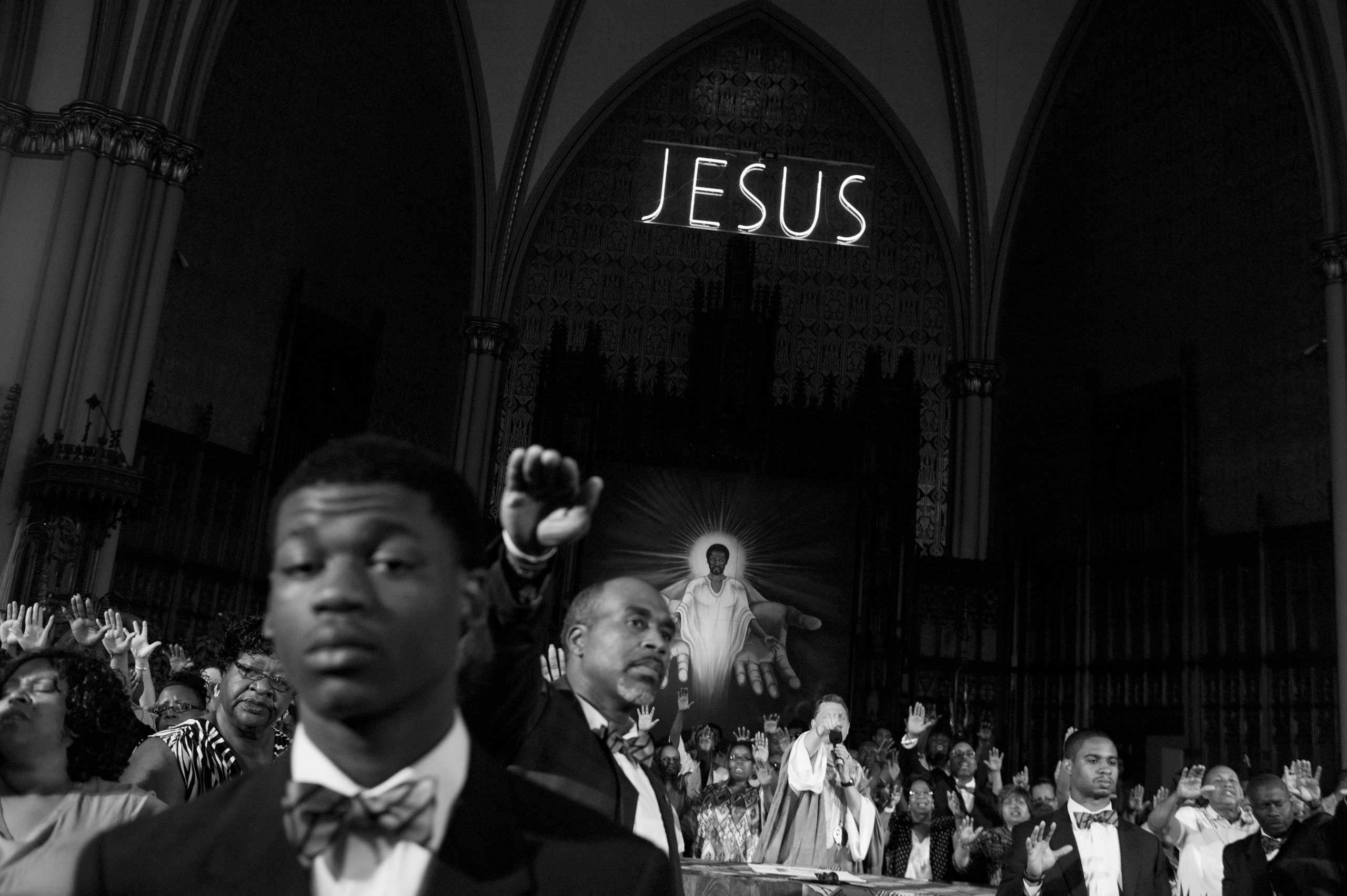 Members of St. Sabina Church in the Auburn Gresham neighborhood pray to end violence in Chicago. More than 40 young people have been murdered in the neighborhood since 2006. Auburn Gresham, Chicago, 2013.