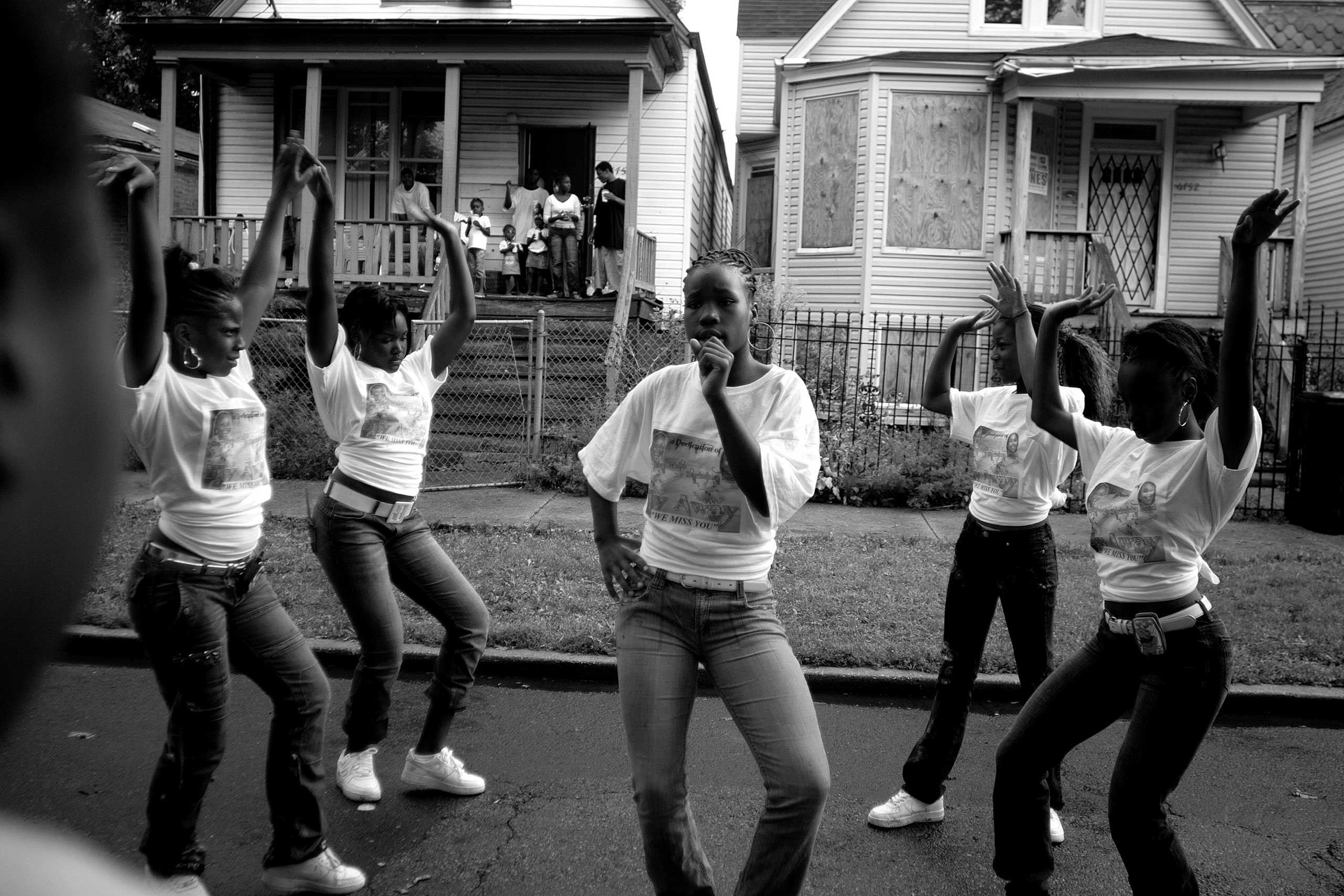 Girls in the Englewood neighborhood on Chicago's South Side attend a block party to celebrate the lives of Starkeisha Reed, 14, and Siretha White, 10. Starkeisha and Siretha were killed days apart in March 2006. The girls' mothers were friends, and both grew up on Honore Street, where the celebration took place. Englewood, Chicago, 2008.