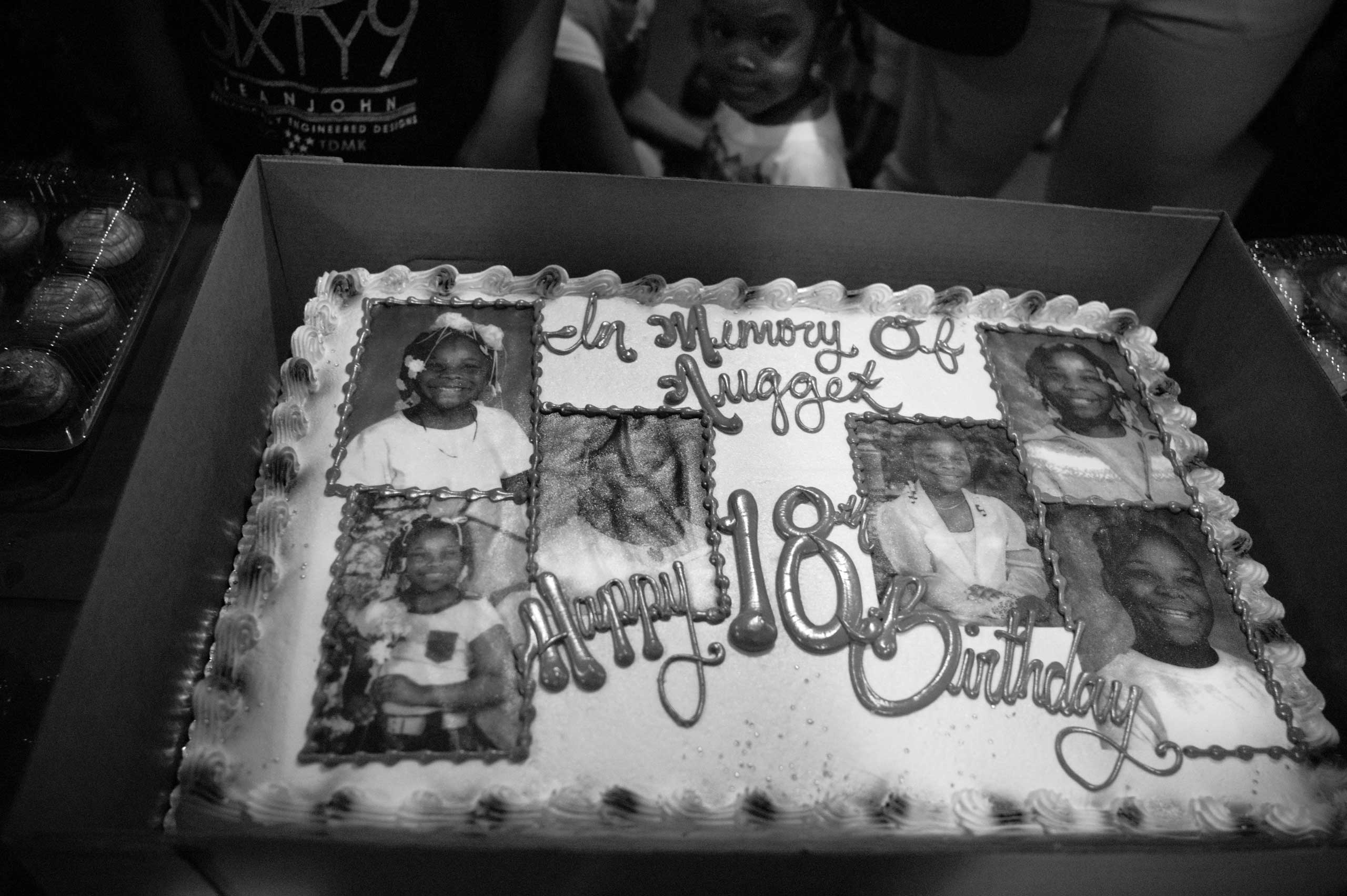 In Memory of Nugget. Seven years after the death of Siretha White, her family celebrates her birthday. She would have been 18 years old that March. Siretha's family never got to cut the cake at her 11th birthday party, the day she was killed. Englewood, Chicago, 2013.                                                                      Side caption: Siretha White's cake, on what would have been her 18th birthday.