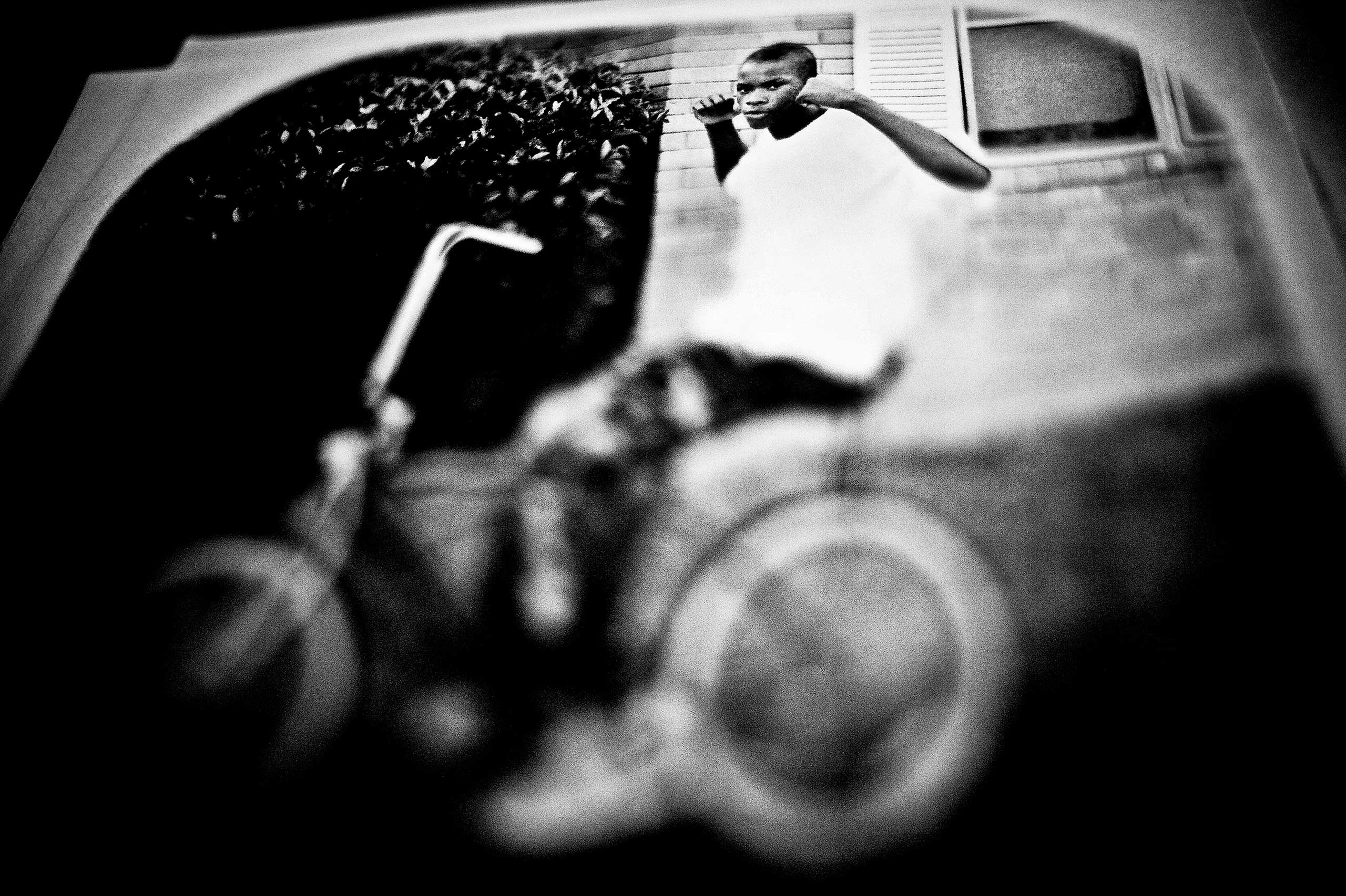 Victims of violence are often memorialized with T-shirts made by their friends and relatives. This is a photograph of a victim for use in his memorial T-shirt. Lawndale, Chicago, 2008.
