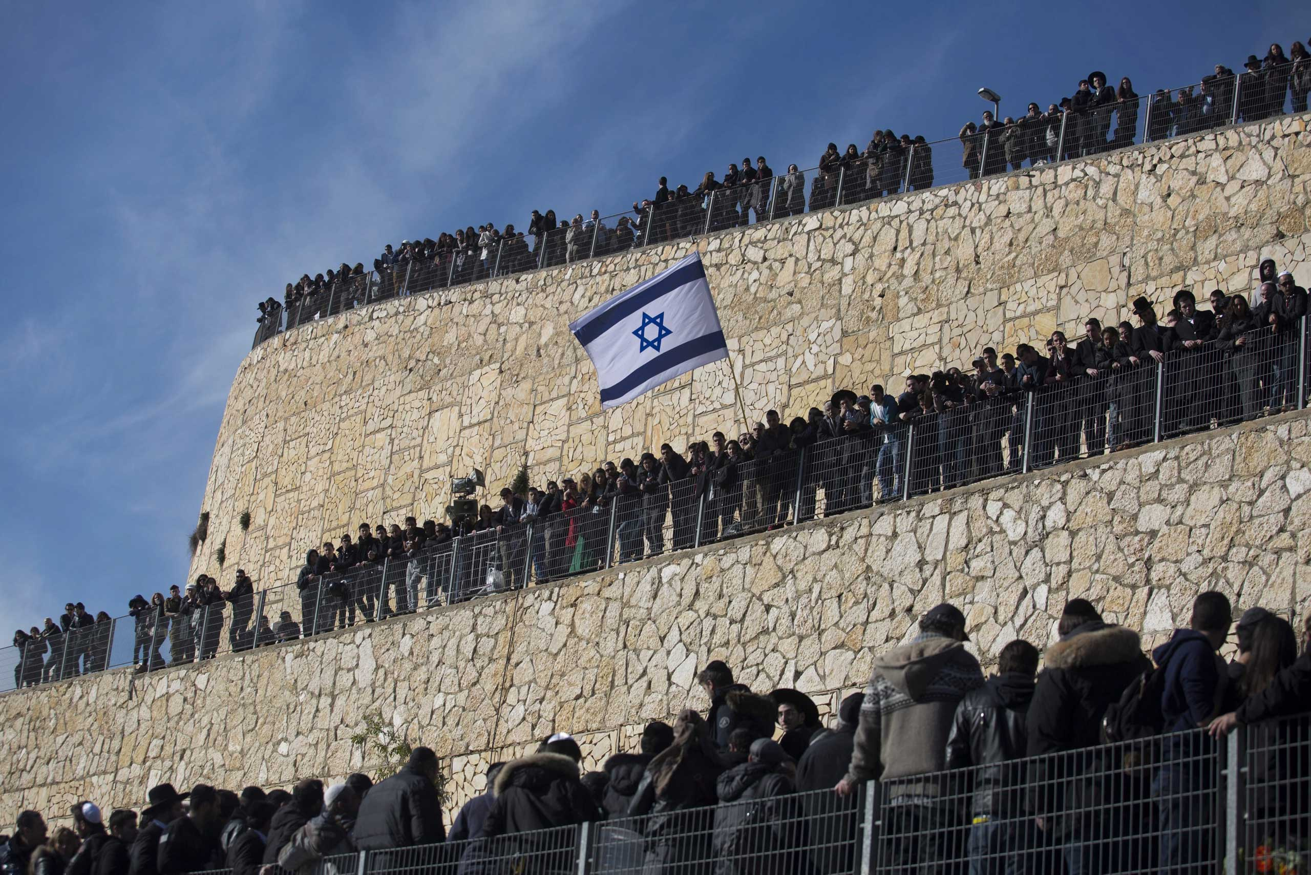 Crowds mourn the four Jews killed in the Paris kosher supermarket attack during a funeral in Jerusalem on Jan. 13, 2015.
