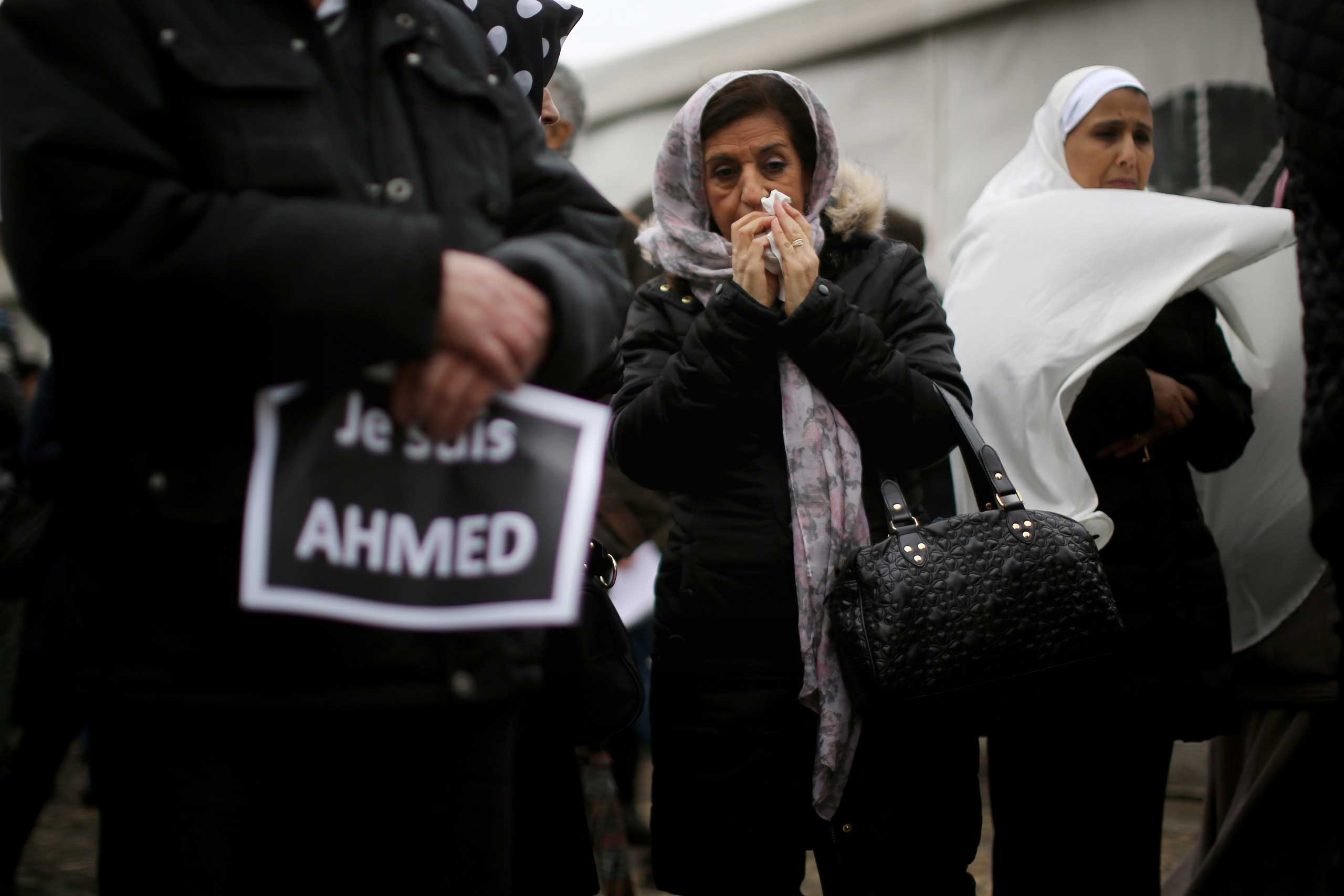 A female mourner reacts during the funeral of murdered police officer Ahmed Merabet at a Muslim cemetery in Bobigny, France, on Jan. 13, 2015.