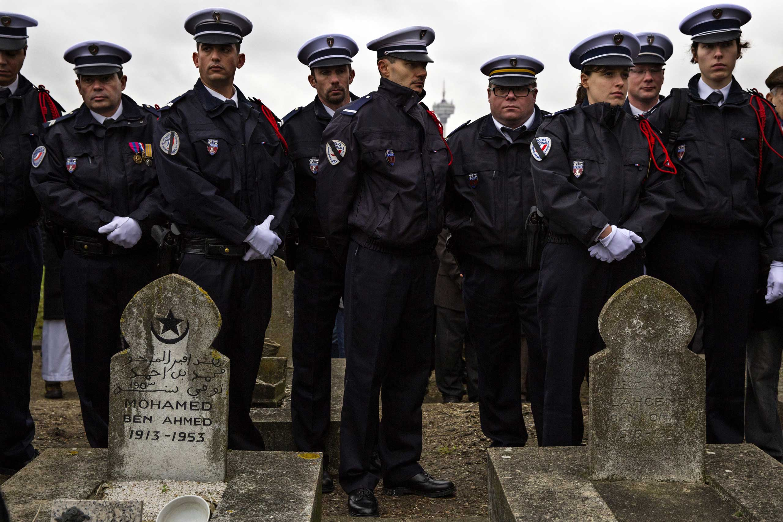 Police Officers line up at the funeral of murdered police officer Ahmed Merabet during the burial at a Muslim cemetery in Bobigny, France, on Jan. 13, 2015.
