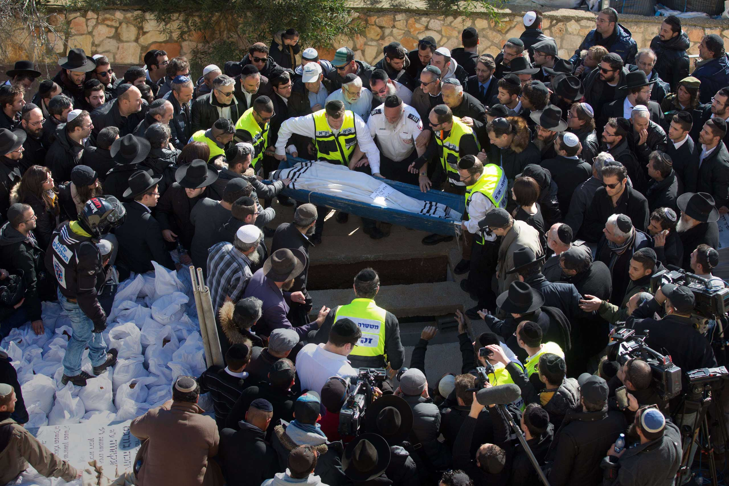 The body of a victim of last week's terror attacks in France is carried ahead of burial at a cemetery in Jerusalem on Jan. 13, 2015.