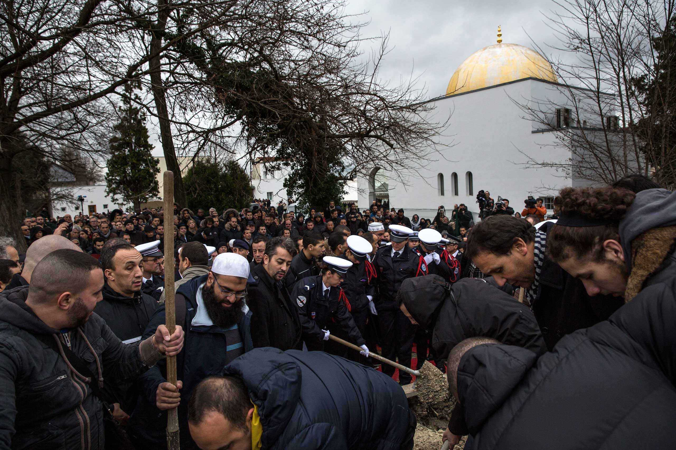 Police officers participate in the burial of murdered police officer Ahmed Merabet at a Muslim cemetery in Bobigny, France, on Jan. 13, 2015.