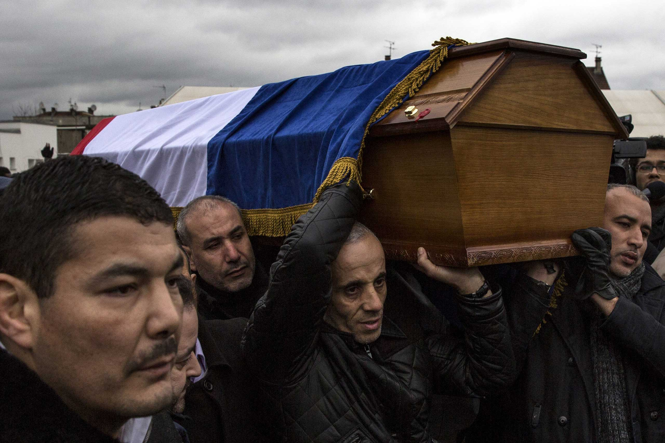 The funeral of murdered police officer Ahmed Merabet takes place at a Muslim cemetery in Bobigny, France, on Jan. 13, 2015.