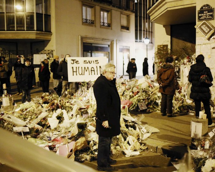 A memorial site for the 12 victims of the terrorist attacks near the offices of Charlie Hebdo, the satirical weekly publication, Jan. 12, 2015.