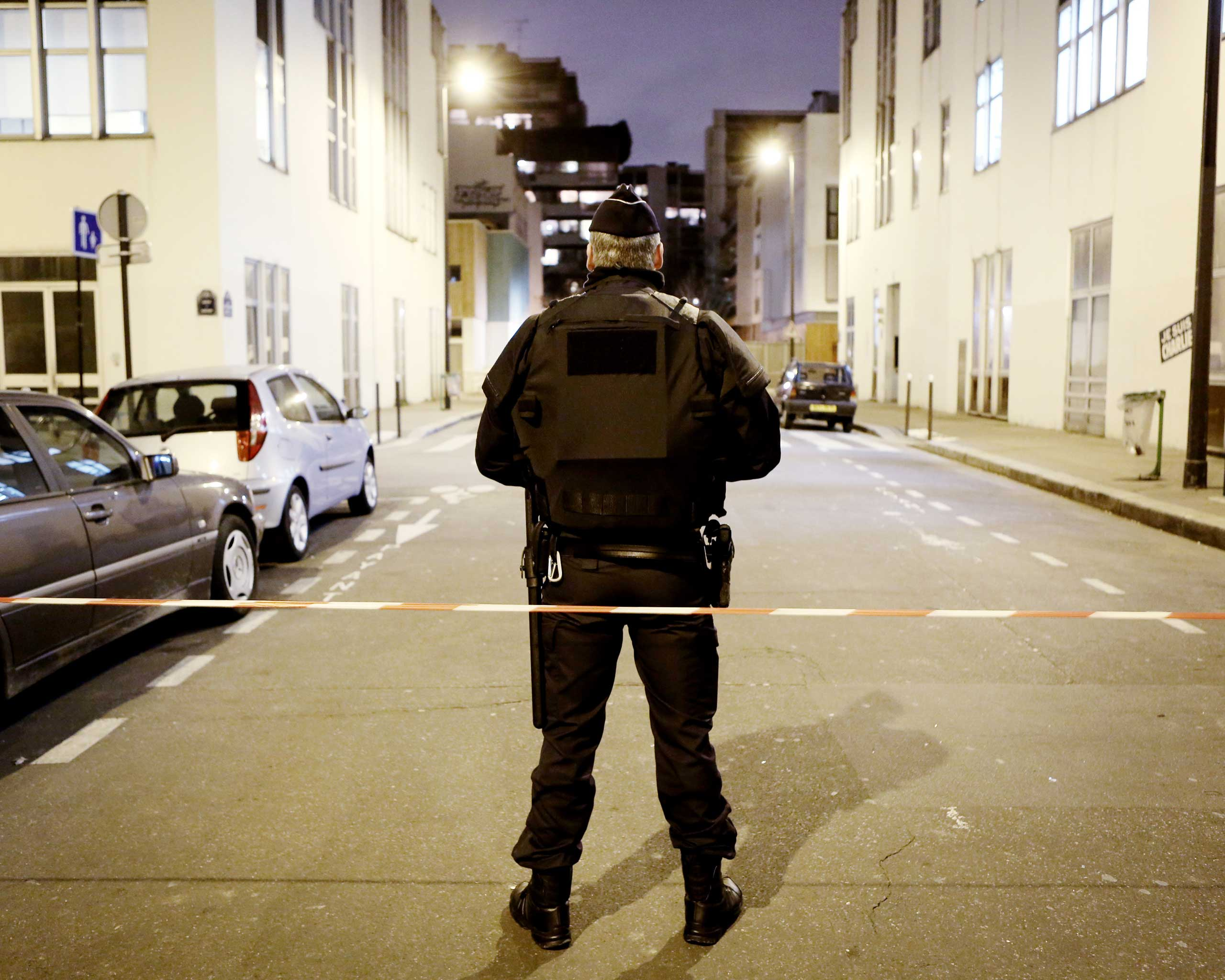 Police guard the area near the Charlie Hebdo offices, as Paris remains on alert after the killings, Jan. 12, 2015.