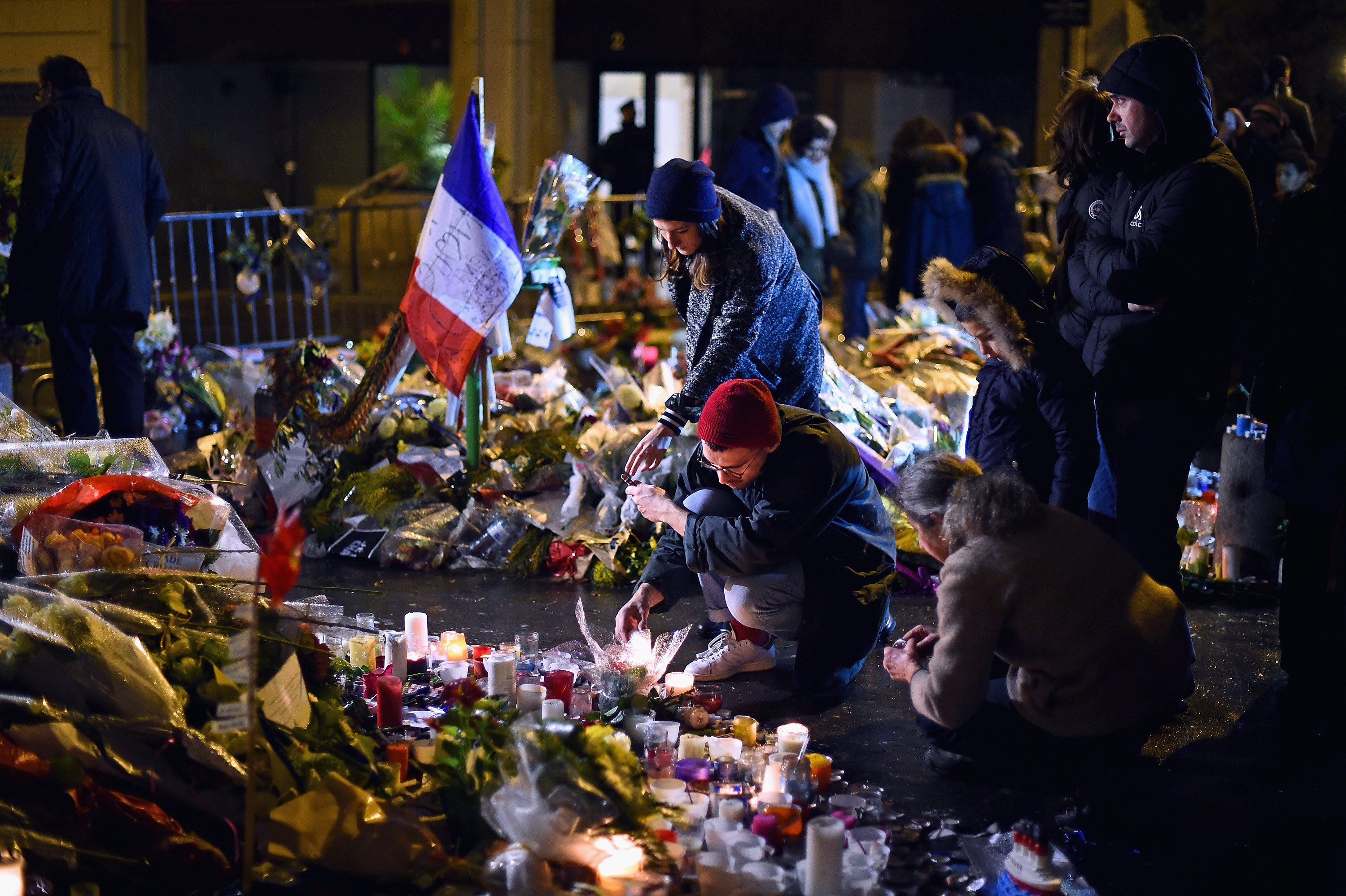 People light candles in tribute near the offices of French satirical magazine Charlie Hebdo on Jan. 10, 2015 in Paris.