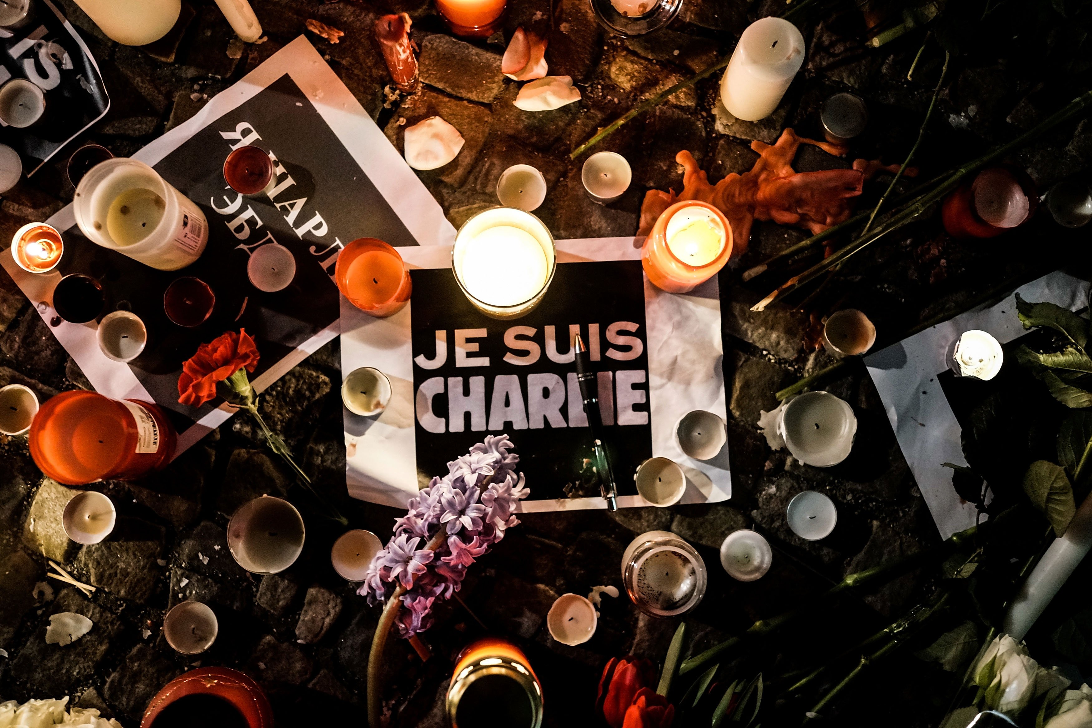 Papers with 'I am Charlie' displayed are left near candles at a vigil in front of the French Embassy following the terrorist attack in Paris on Jan. 7, 2015 in Berlin.