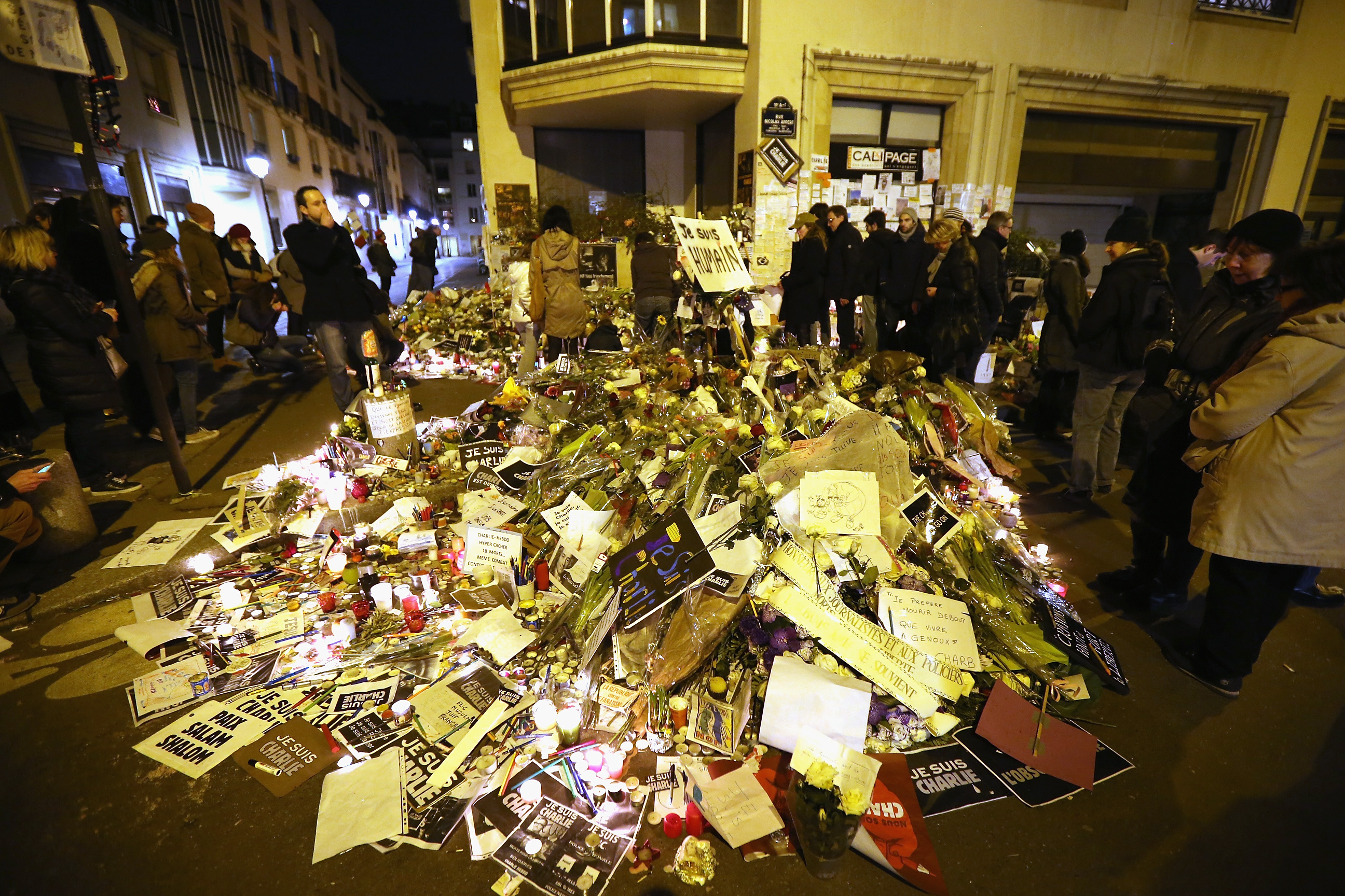 Remembrance: Tributes mounted outside the Charlie Hebdo office after the Jan. 11 unity parade in Paris