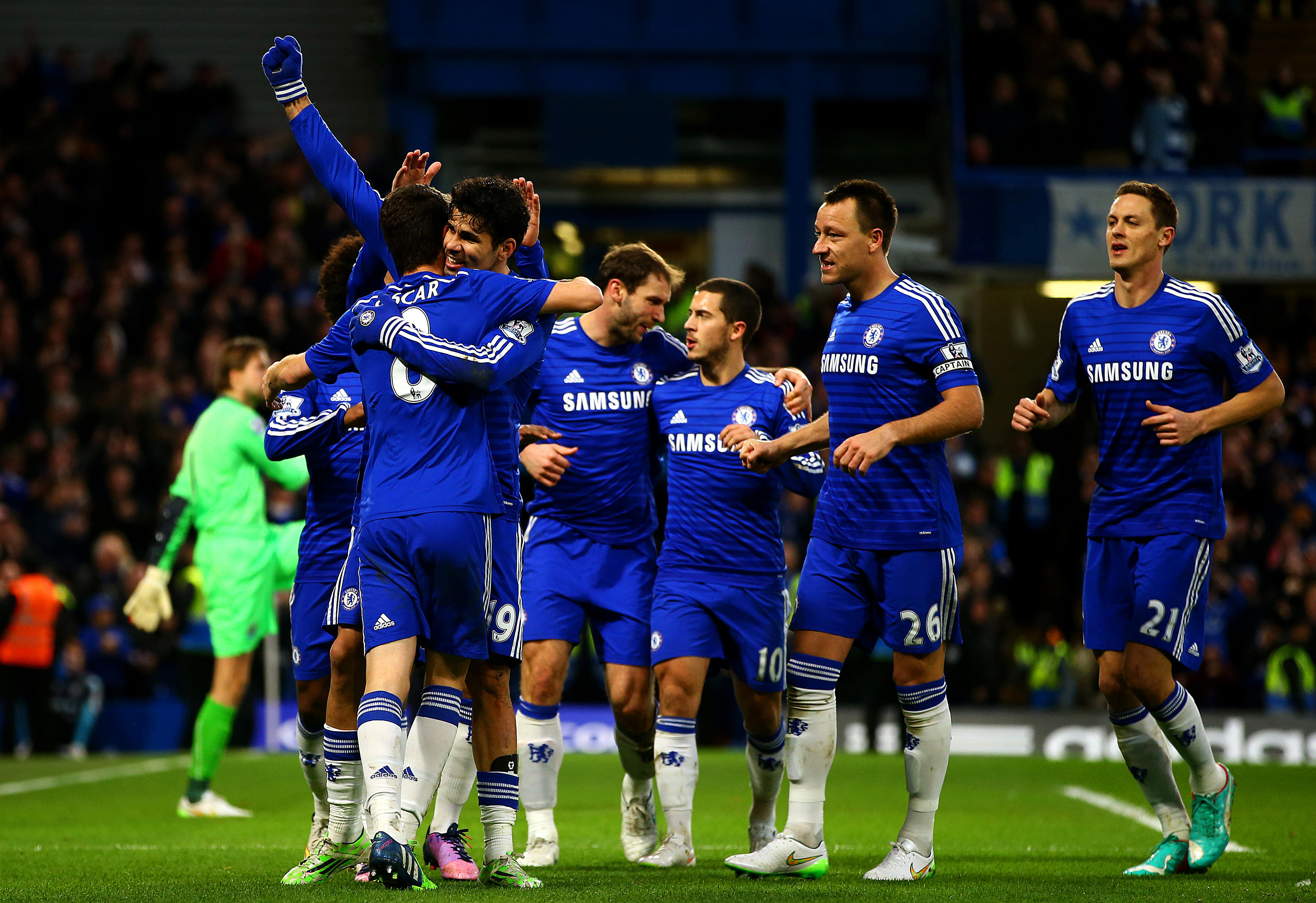 Diego Costa of Chelsea celebrates with team-mates after scoring his team's second goal during the Barclays Premier League match between Chelsea and Newcastle United at Stamford Bridge on Jan. 10, 2015 in London.
