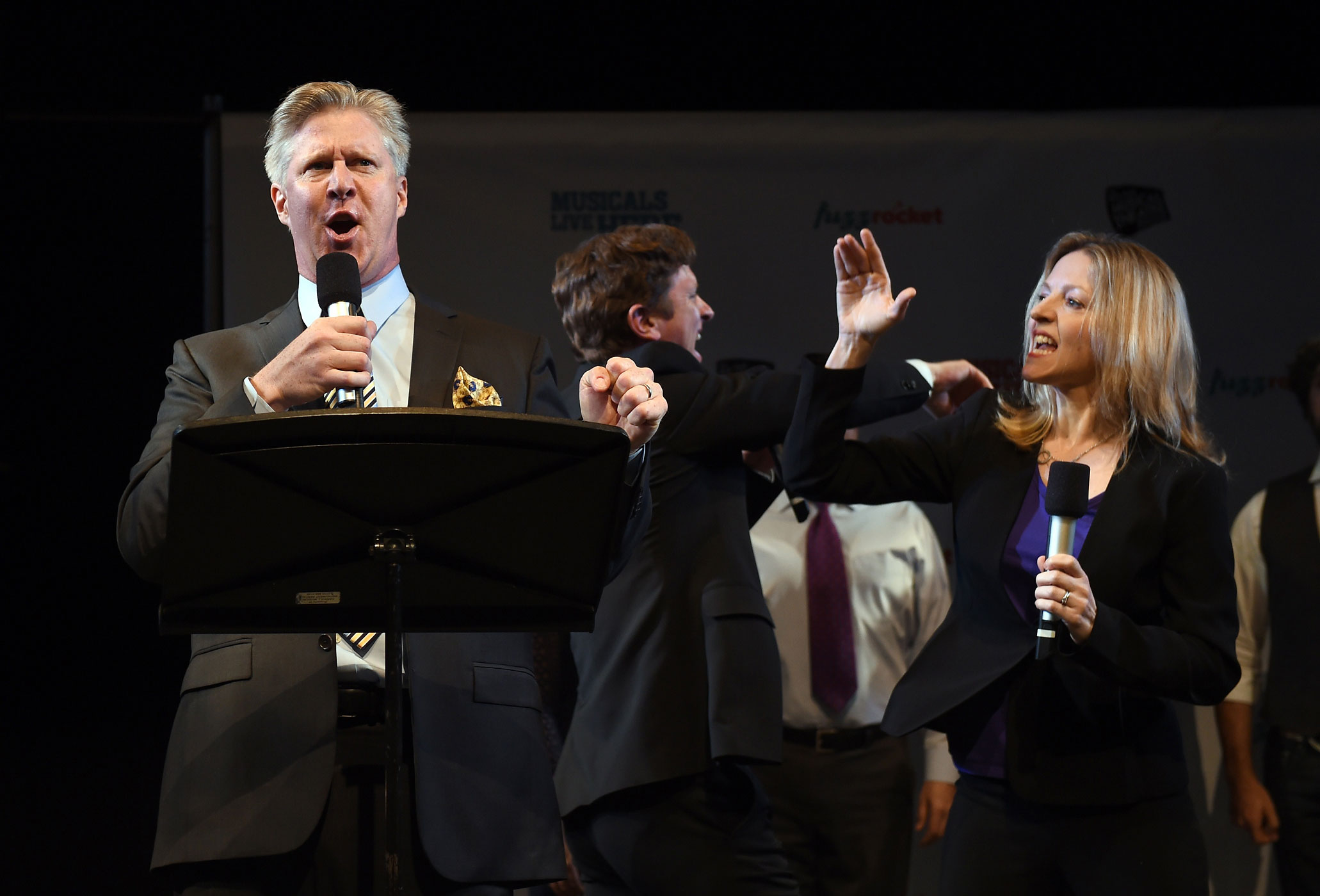 Karl Kenzler, left, Alet Taylor, right, and Duke LaFoon, center, perform a song from Clinton: The Musical during the New York Musical Theatre Festival special preview on July 2, 2014.