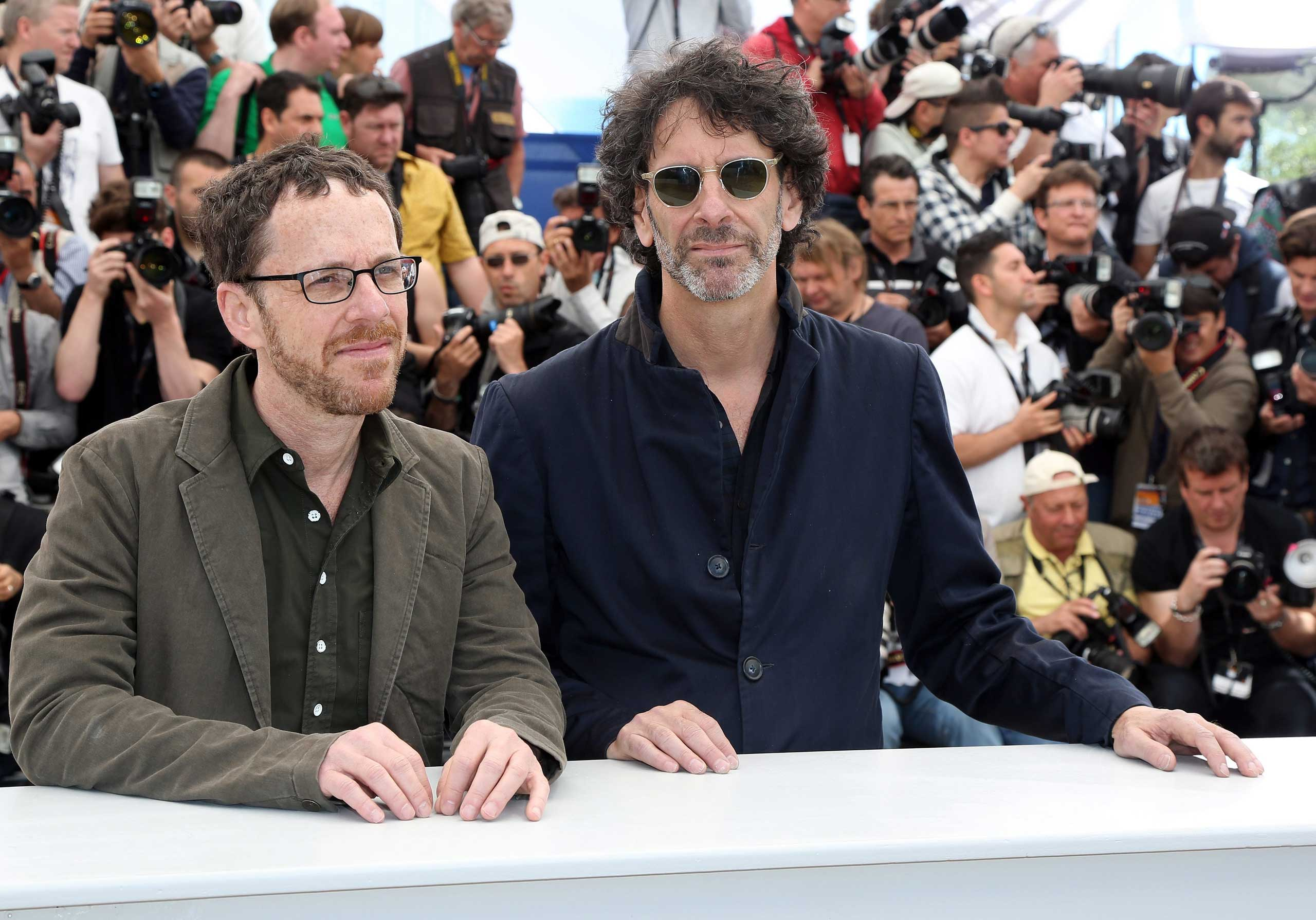 Directors Ethan Cohen (L) and Joel Cohen (R) during the photocall for 'Inside Llewyn Davis' at the 66th annual Cannes Film Festival in Cannes, France, May 19, 2013.