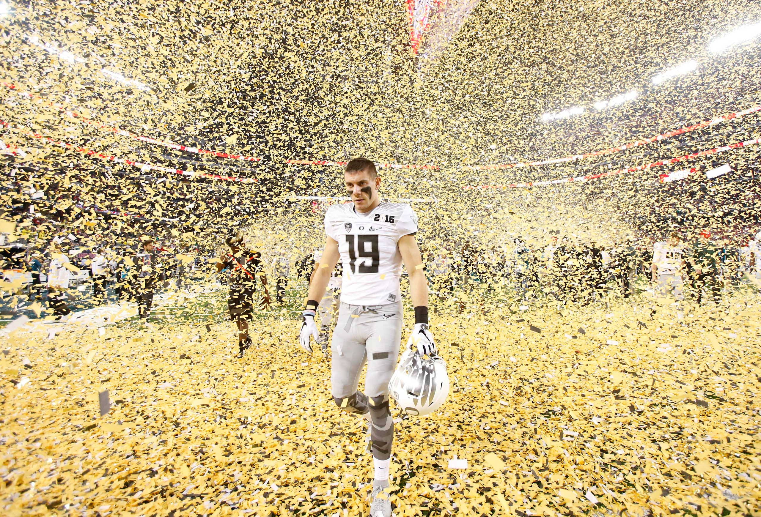 Oregon Ducks wide receiver Austin Daich (19) walks off the field after losing to the Ohio State Buckeyes in the 2015 College Football Playoff National Championship Game on Jan. 12, 2015 in Arlington, Texas.