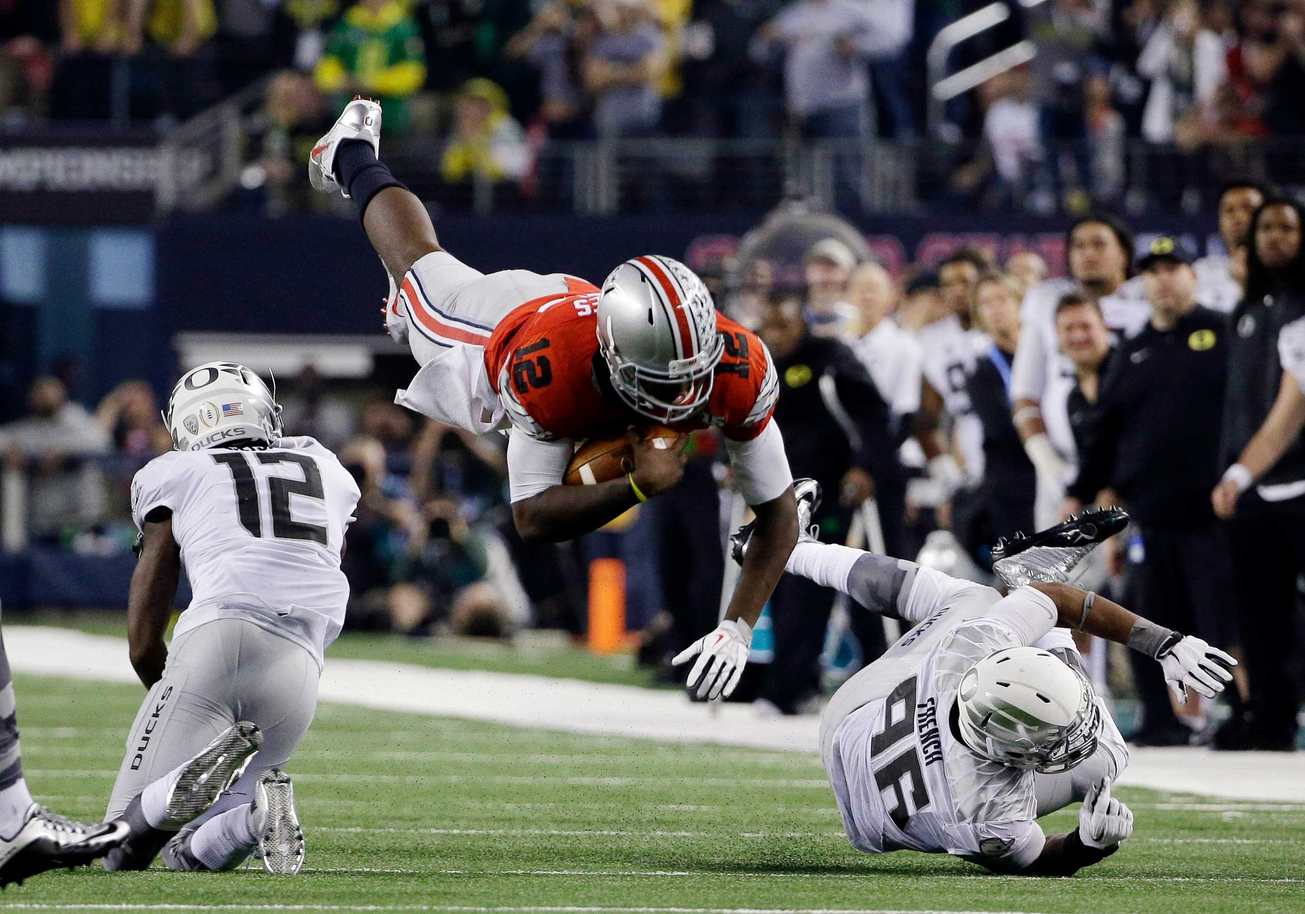 Ohio State's Cardale Jones (12) dives for a first down during the second half of the NCAA college football playoff championship game against Oregon on Jan. 12, 2015, in Arlington, Texas.