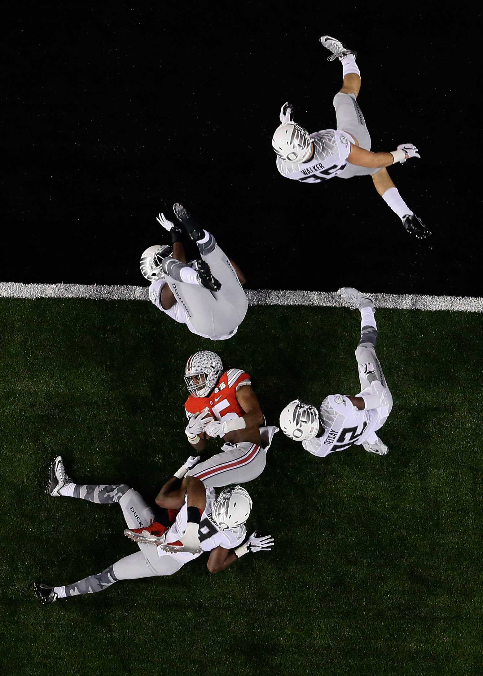 Ohio State's Ezekiel Elliott (15) is stopped short of the goal line during the NCAA college football playoff championship game against Oregon on Jan. 12, 2015, in Arlington, Texas.