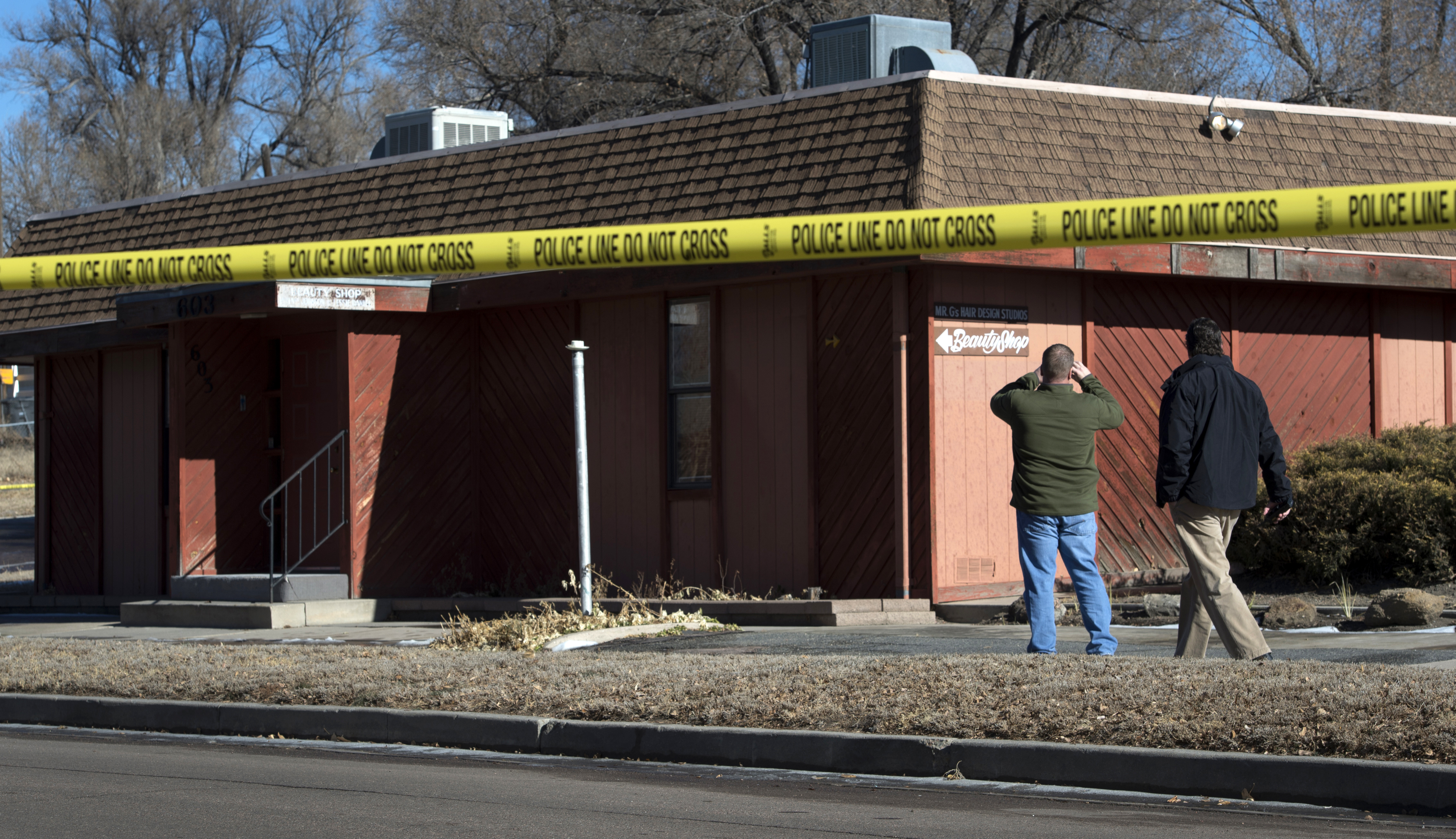 Colorado Springs police officers investigate the scene of an explosion on Jan. 6, 2015, at the NAACP's offices in Colorado Springs, Colo.
