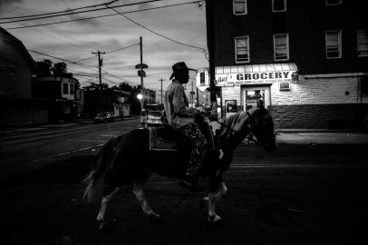 Shahir Drayton, 17, rides his horse back to the stables after a ride through the streets of southwest Philadelphia.