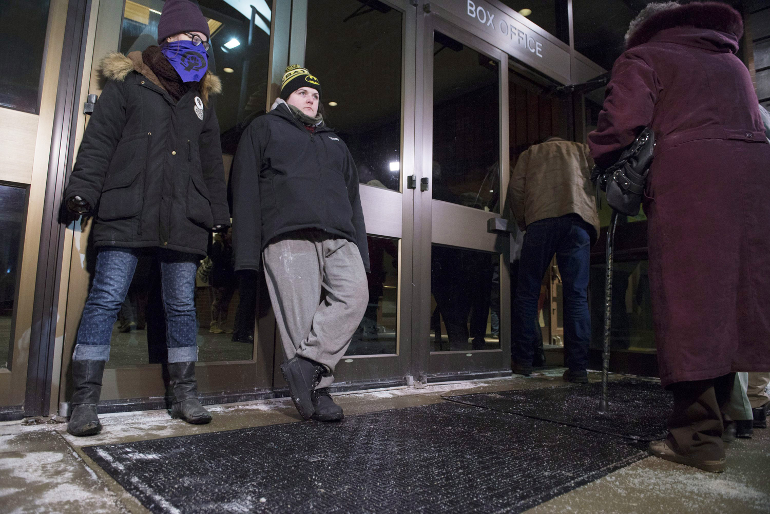 Protesters stand against doors at the entrance to the Centre in the Square theater in Kitchener, Ontario, Canada on Jan. 7, 2015 to protest Bill Cosby.
