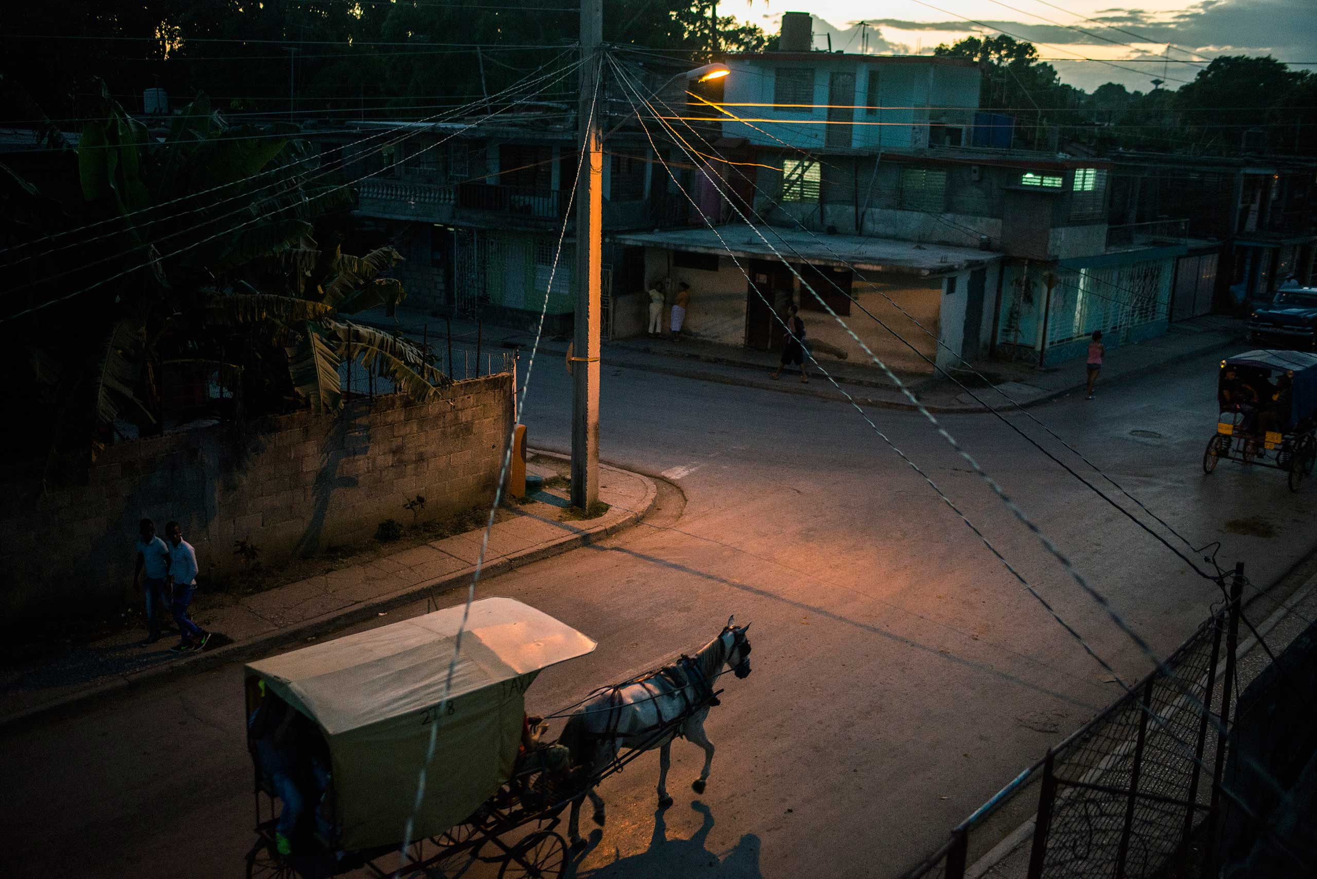 The New York Times: Revealing a Slowly Changing CubaA horse-drawn carriage -- the main form of transportation locally -- navigates the streets of Guantanamo, Cuba, near the island's eastern end, Jan. 1, 2015.
