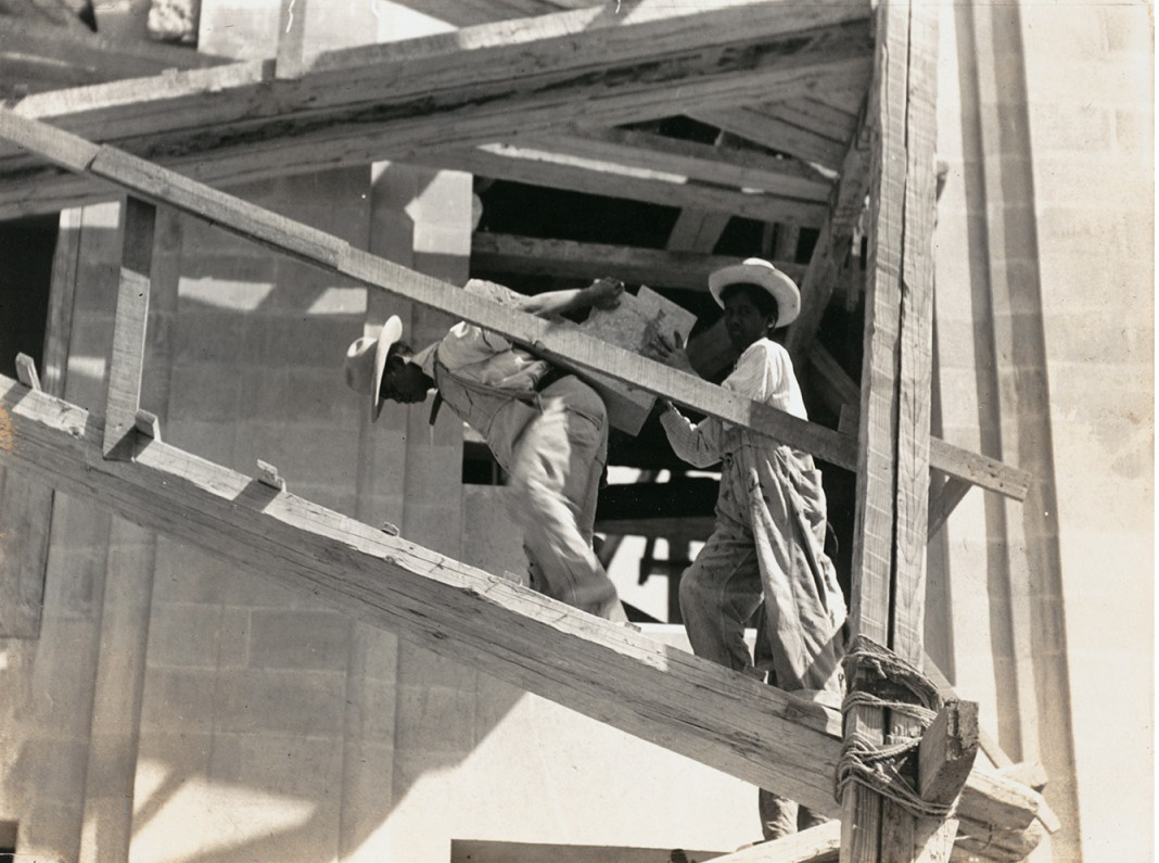 """Untitled [""""Indians carrying blocks of stone on their back for the construction of a building""""], ca. 1927"""