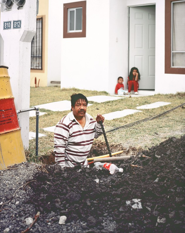 Man Digging Hole to Build a Fence for His New House in Juarez