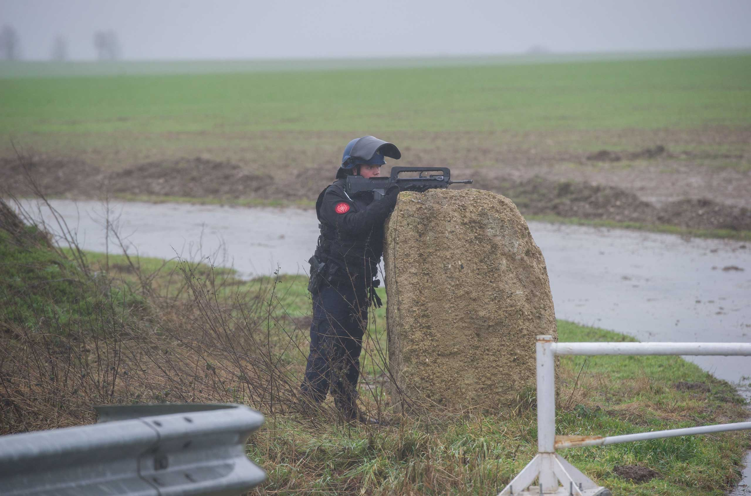 French police officers patrol in Dammartin-en-Goele where two brothers suspected of slaughtering 12 people in an Islamist attack on French satirical newspaper Charlie Hebdo held one person hostage as police cornered the gunmen, on Jan. 9, 2015.