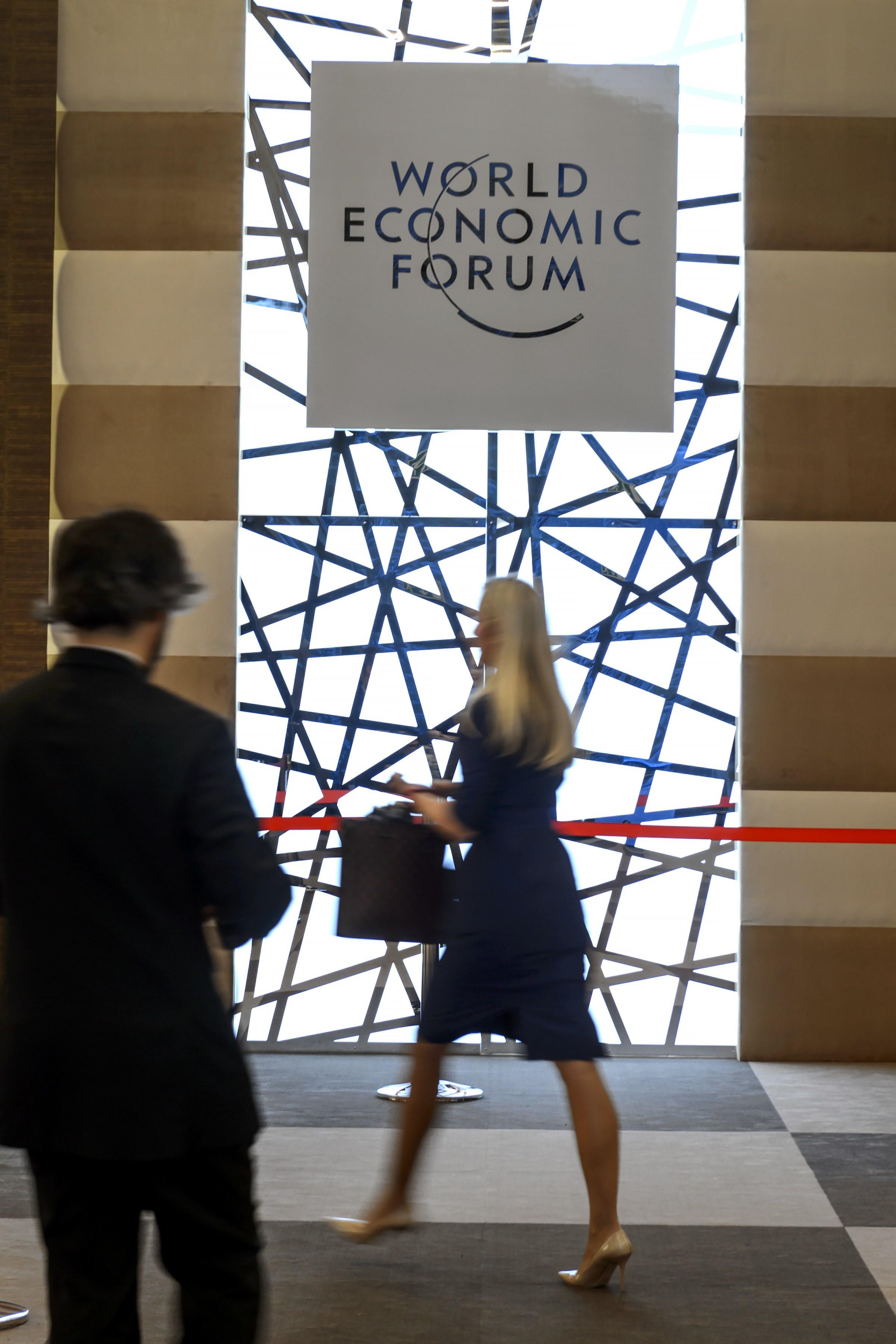 People enter the World Economic Forum (WEF) in Davos, Switzerland on Jan. 20, 2015.