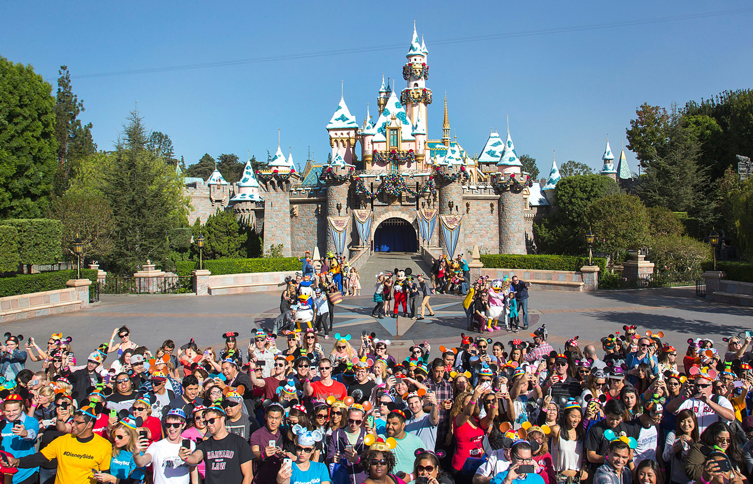 More than 1,000 fans gather for a photo at Disneyland in Anaheim, Calif.